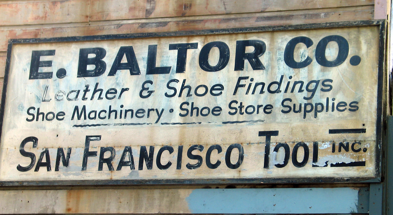 E. Baltor Co.  A sign I found in the Mission District in 2001. No longer there.