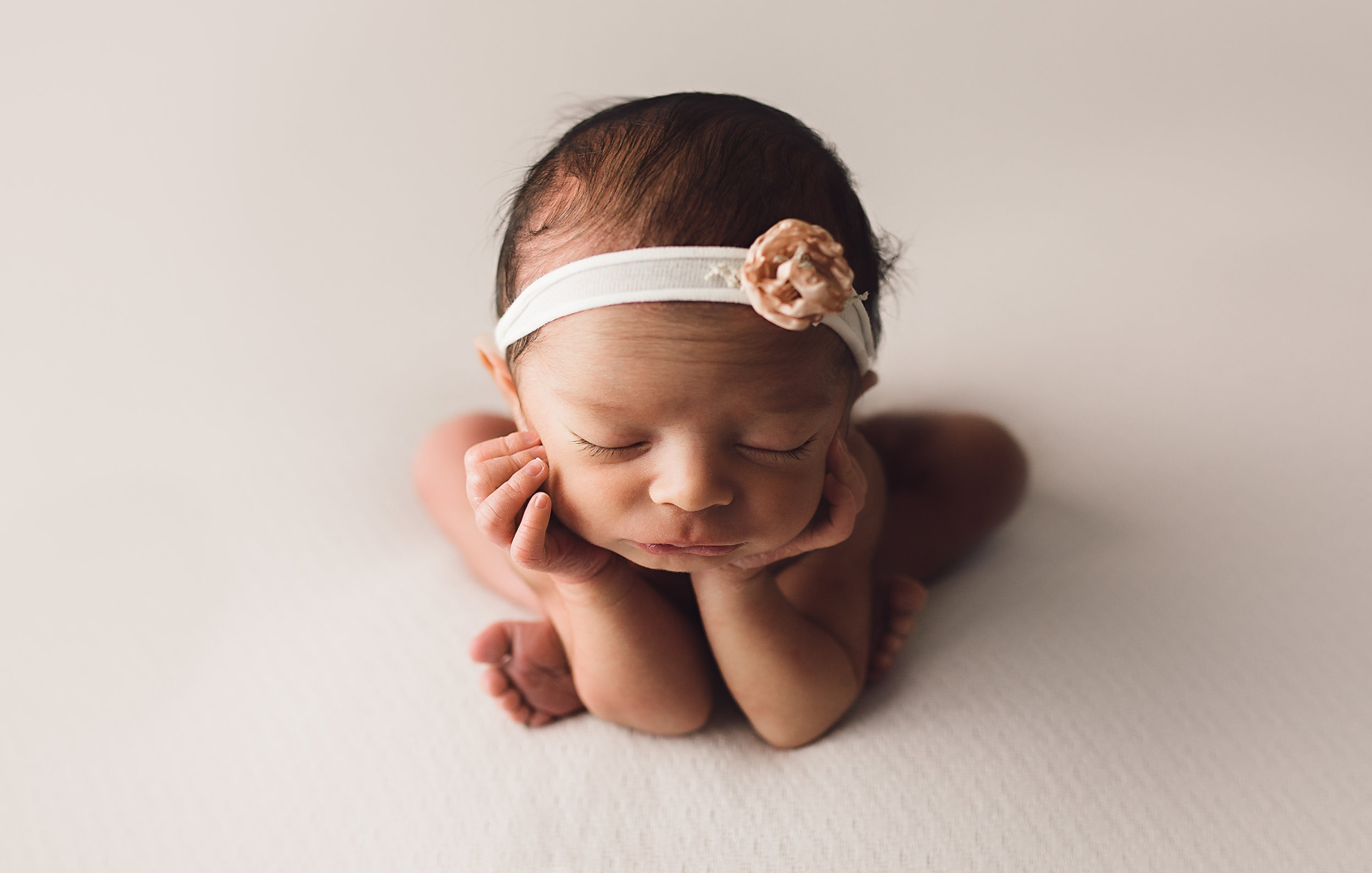 Essex-county-newborn-photographer-froggy-pose-baby-headband-white-girl