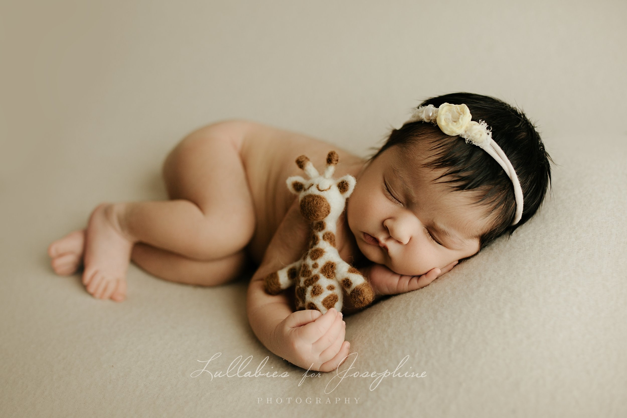 NJ-newborn-photographer-baby-sleeping-giraffe-headband