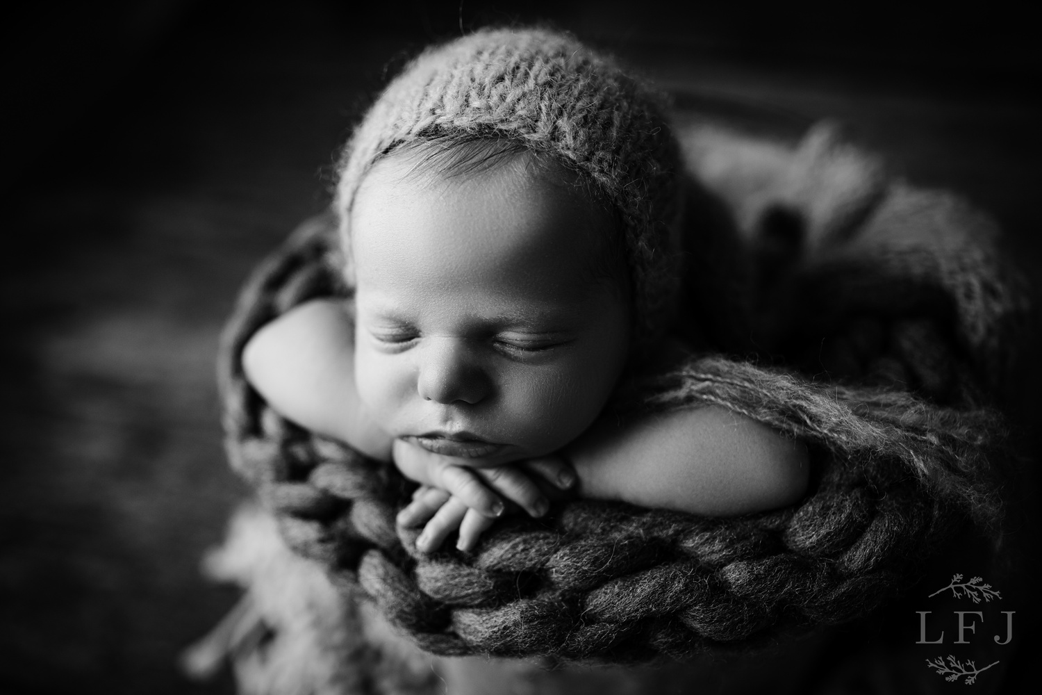 black and white image of baby boy in a bucket