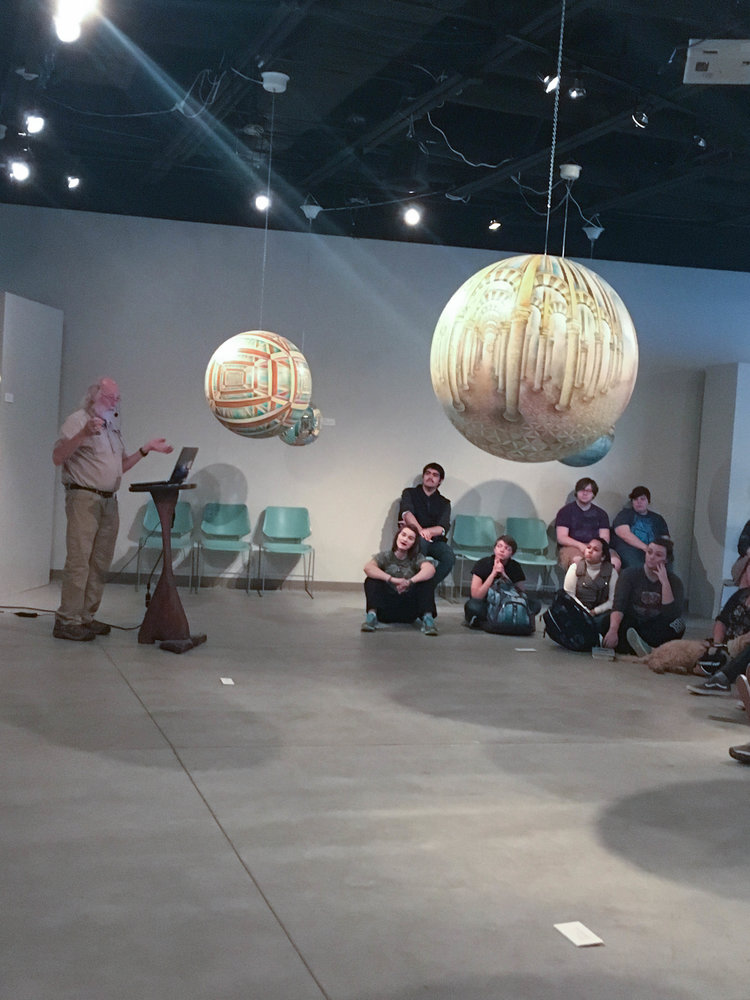 Dick Termes talking to the students at Buena Vista University in the gallery.