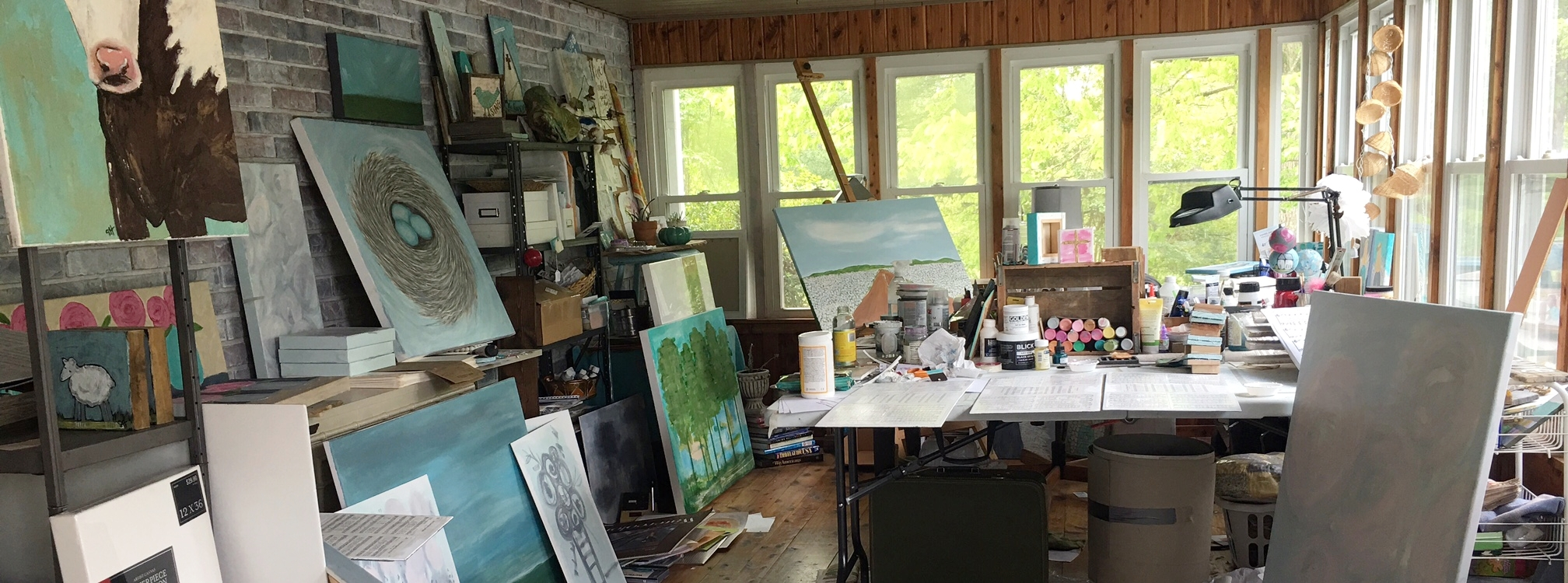 The creative chaos that is my home studio.
