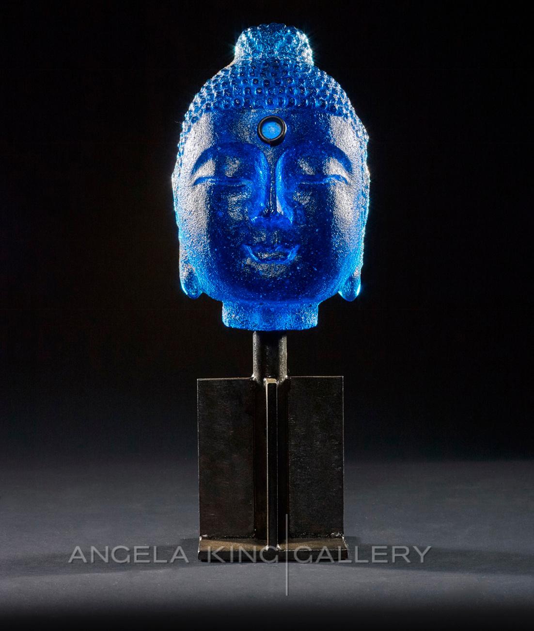 Vibrant Blue Bookshelf Buddha