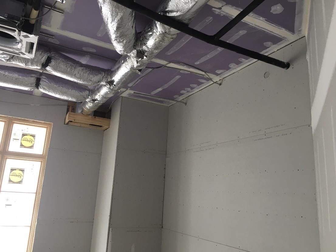 Gypsum Board and Duct Work in a Classroom