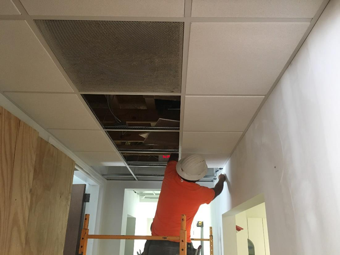 Installing Ceiling Tiles at Connector Hallway