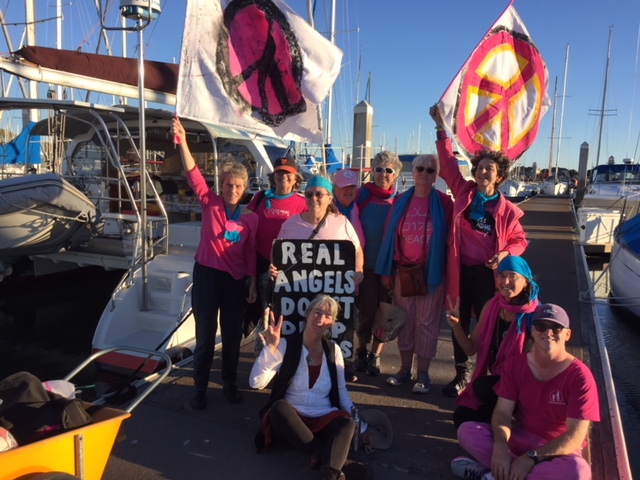"""After a peacemaking day on the bay, with """"Captain Jan"""" on the right. Photo by Rebekah Bowman"""
