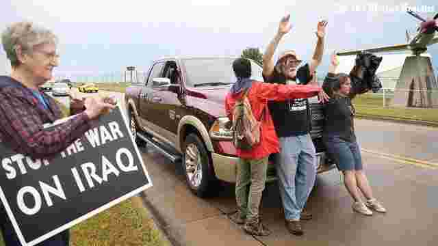 Protesters gather to block road in front of Des Moines Air National Guard drone control center on June 28, 2017. Frank Cordaro, author of this article, is the man wearing the hat. Des Moines Register Photo.