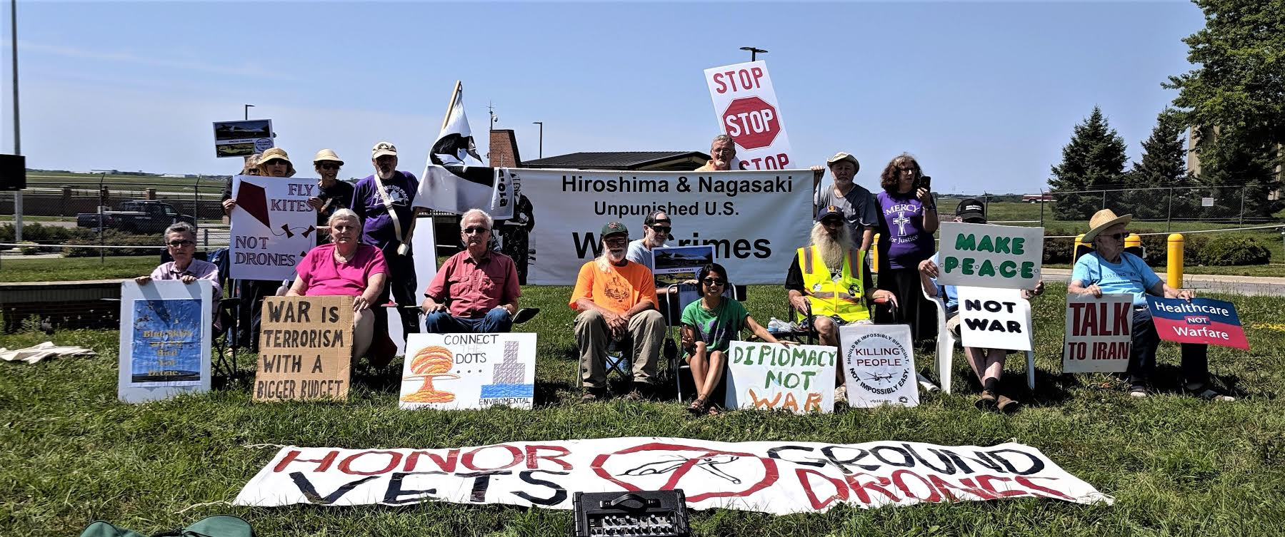 Members of the Des Moines Catholic Worker, Veterans for Peace and others protesting nuclear and drone war at the Des Moines Iowa Air National Guard base on August 9, 2019.