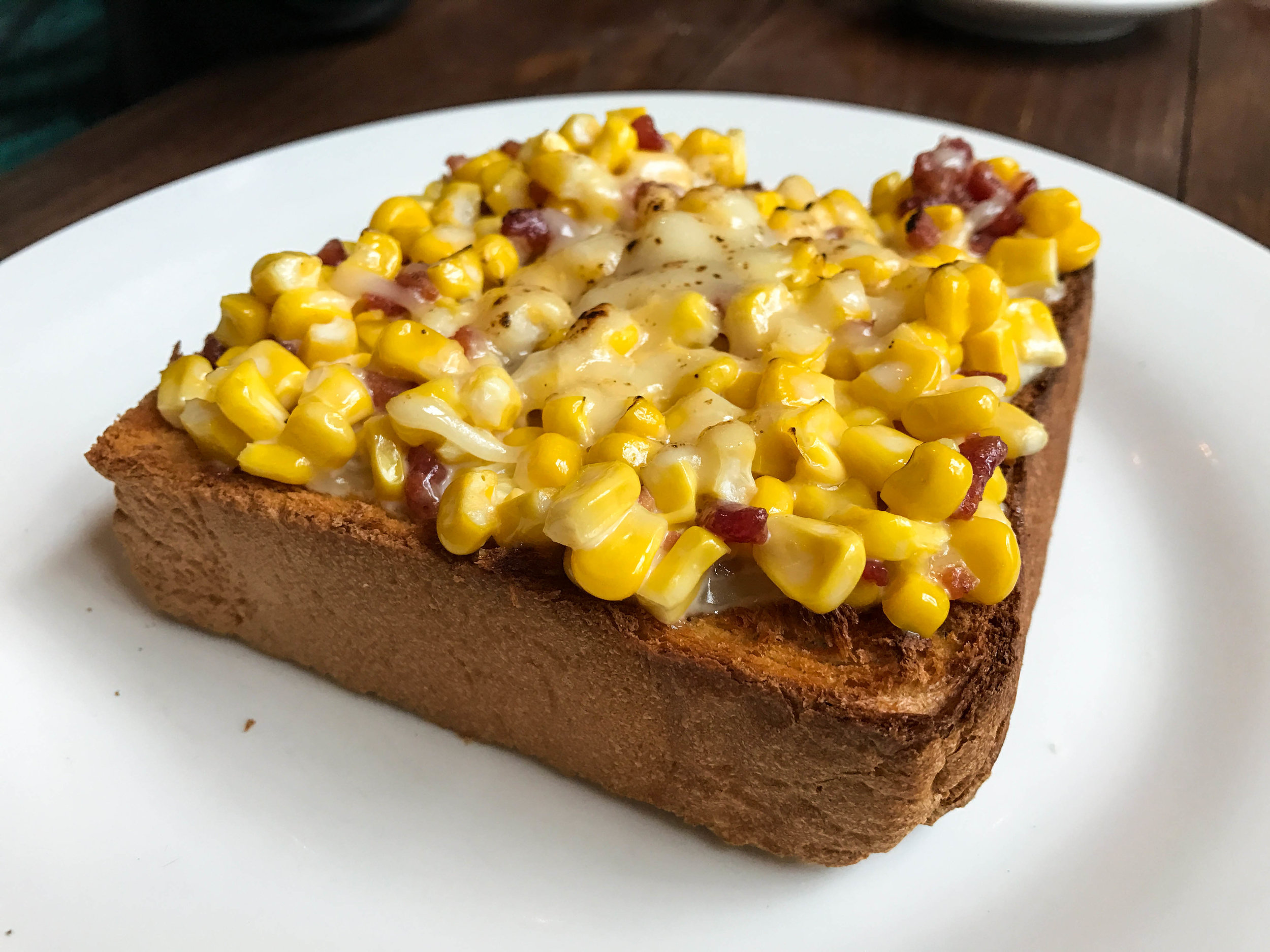 Creamed corn, bacon, and cheese toast