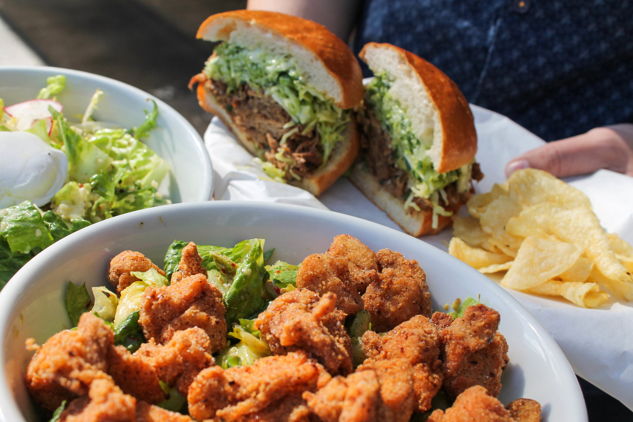 Fried chicken salad, poached egg and bacon salad, and their Spicy Hog sandwich