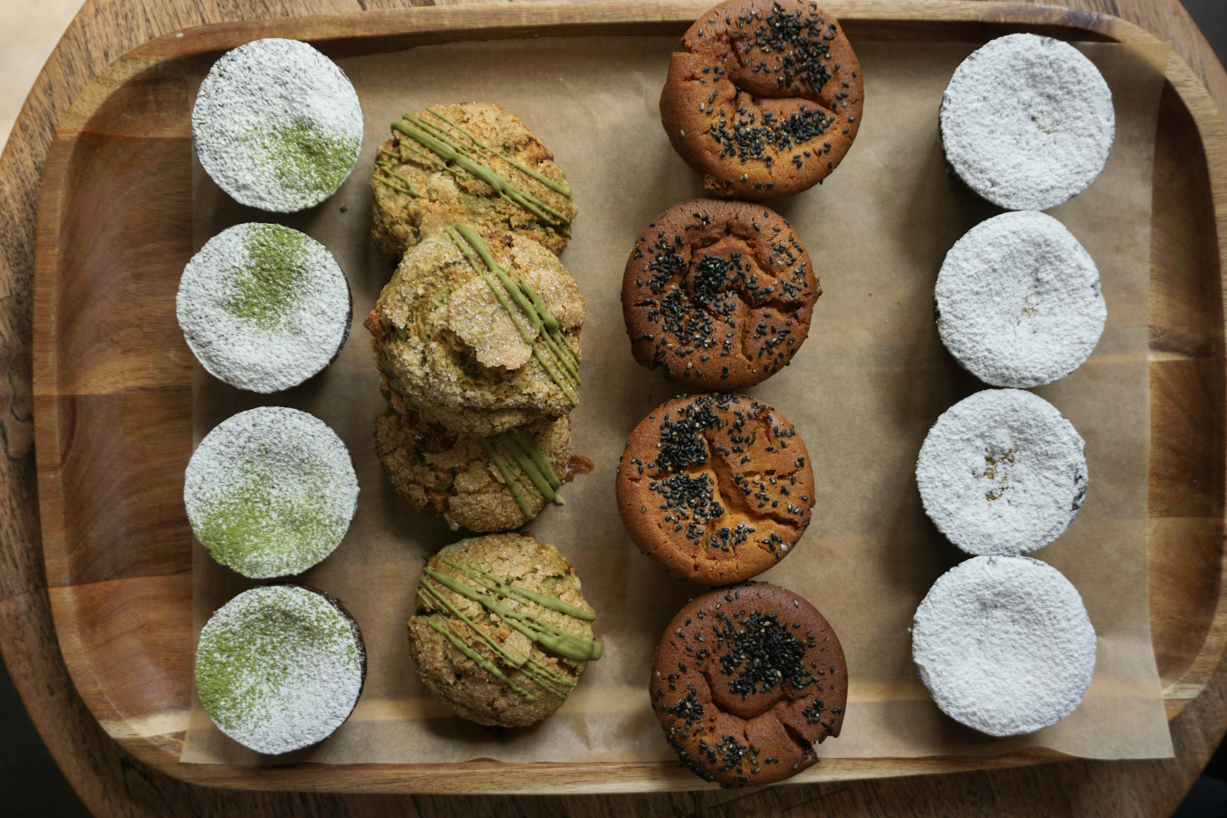 From the left: matcha custard cake, matcha white chocolate scone, mochi muffins, and rum custard cakes