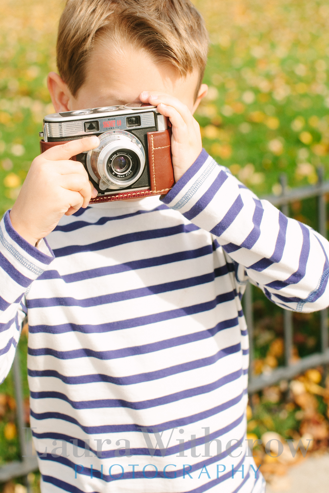 boy with old camera