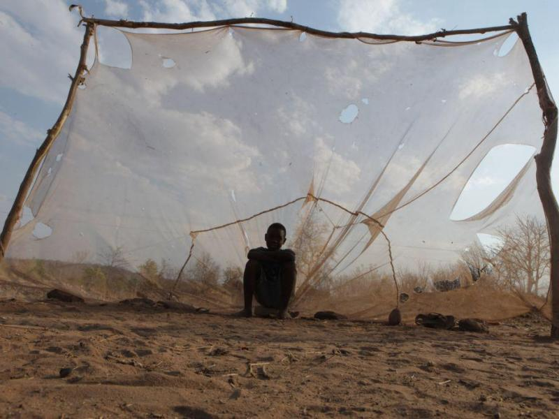 A mosquito net being used as a goal post net in Zambia (Photo by Moisés Mwape, AP 2014)