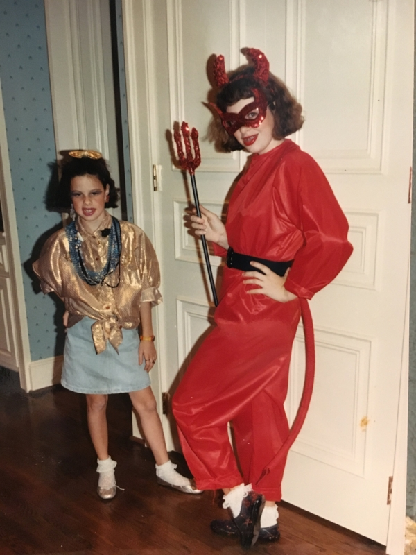 """I'm not sure what sister's character was. The """"costume"""" she is wearing is what I wore to school like every Friday of 6th grade."""