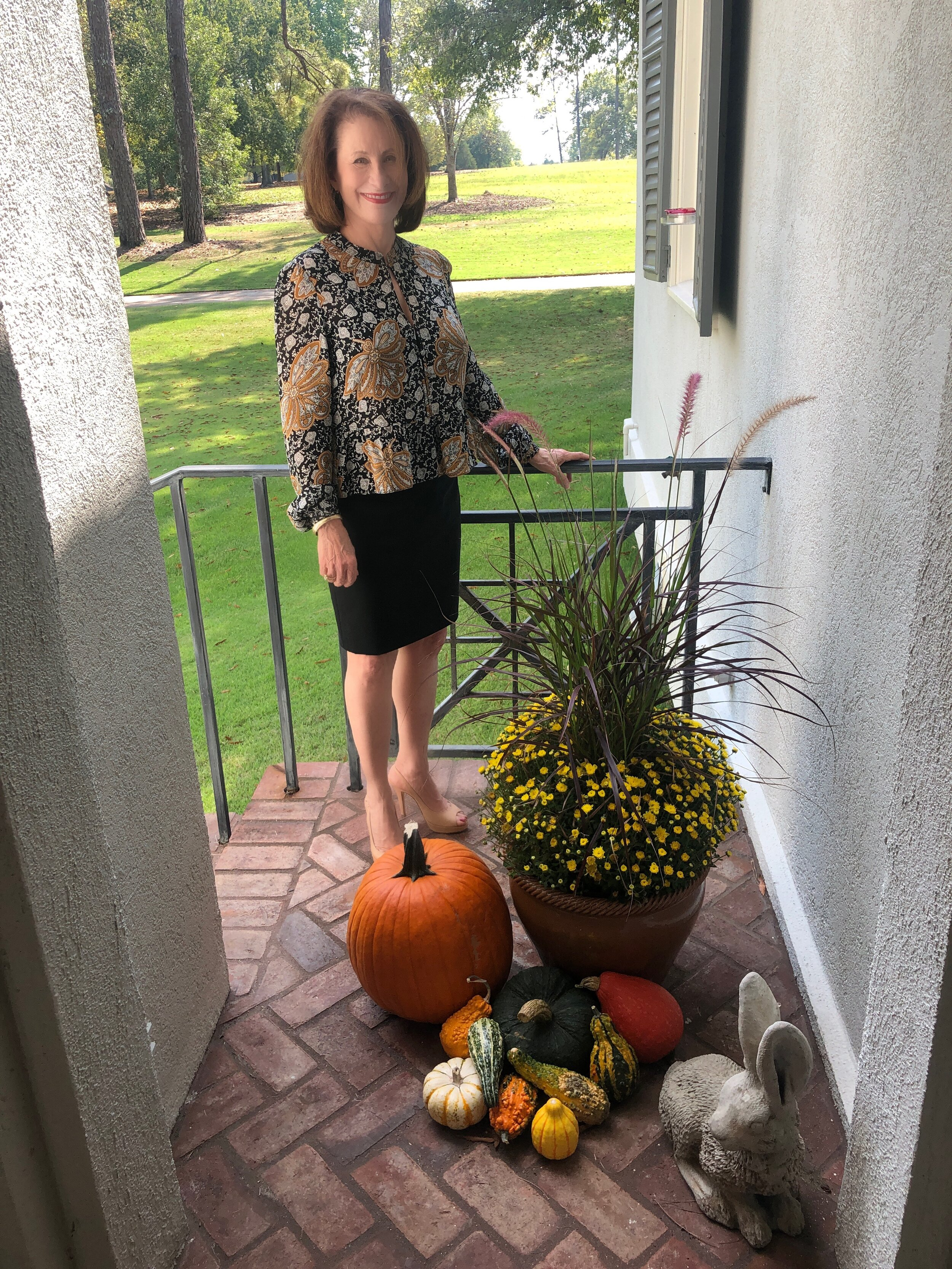 Diane posing with 2019 back door fall display.