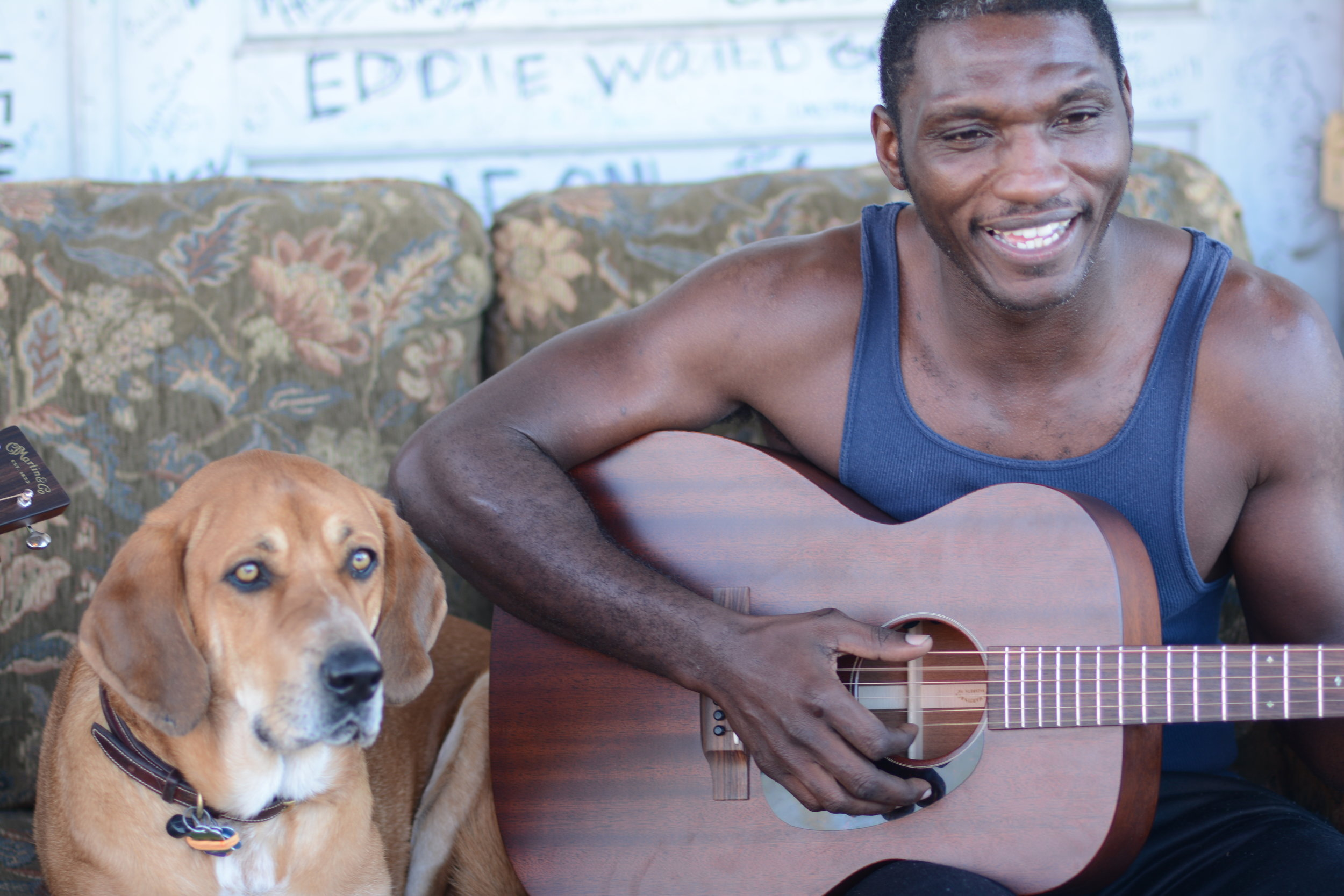 Multiple Grammy nominated artist Cedric Burnside and his four legged friend Abigail on the porch at Ground Zero Blues Club, Clarksdale, Mississippi.