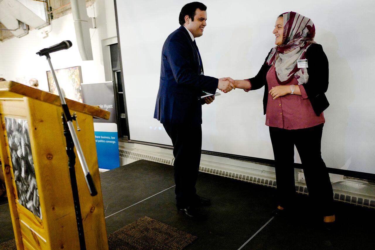 Edgar Barraza (left) accepts his Immigrant Liberty Award from Master of Ceremonies, Nadeen Ibrahim.