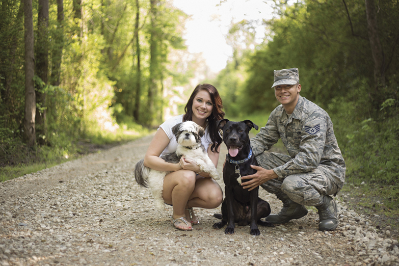 2015 Operation Military Pets grant recipient, U.S. Air Force Staff Sgt. Justin Hernandez and his wife, Jessica, with their dogs Bennie and Diesel.