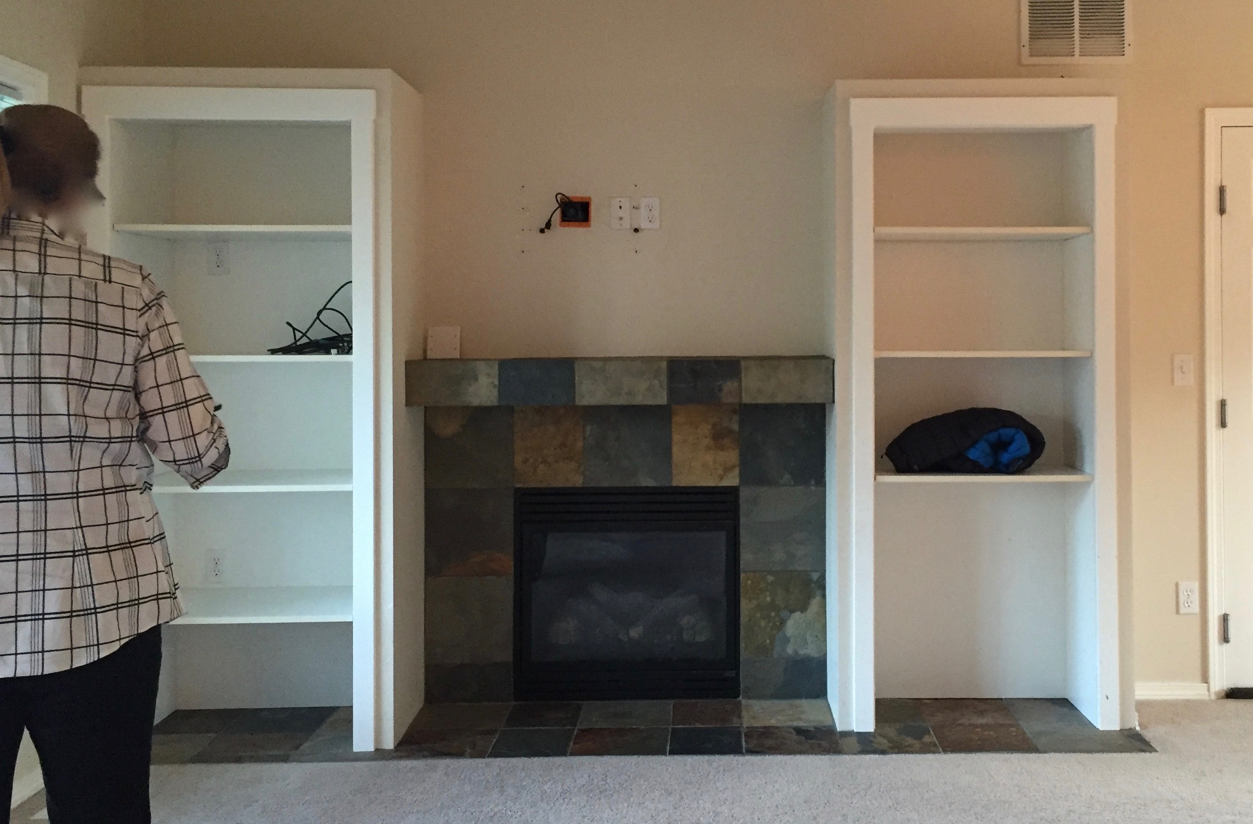 Before: Built-in shelves, old fireplace, old dirty carpet, yuck!