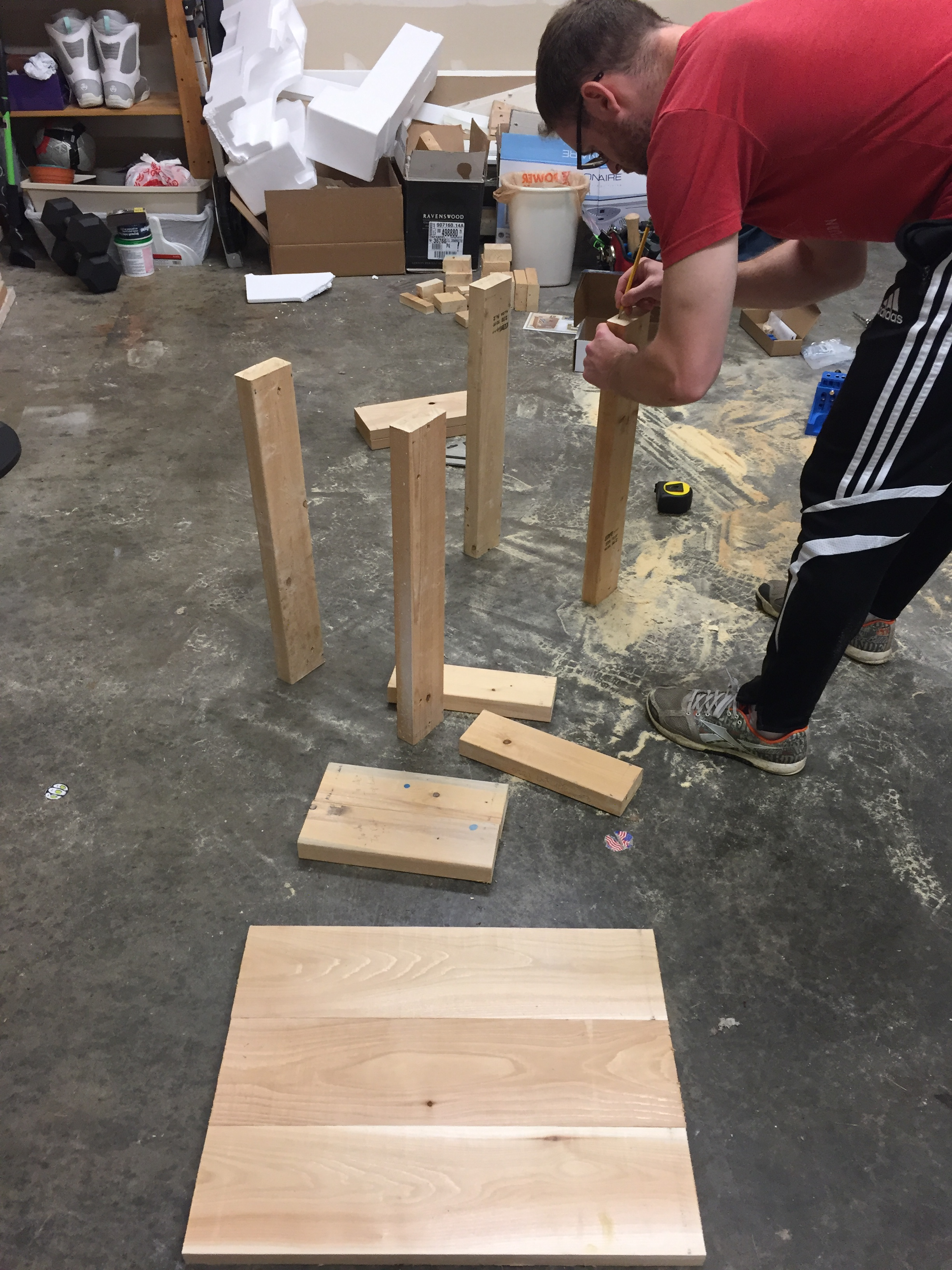Marking our cut pieces to make sure we had our favorite sides showing. We used cedar for the table top, and screwed the pieces together with pocket hole screws.