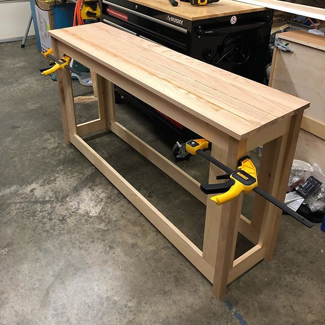 The latest DIY project in the works: a sofa table with storage! All the joinery is done with dowels, minus the plywood panels which are stapled in (and has a workbench on top to keep it flat 😂). Next step is to sand everything, then glue up the dry fitted frame, sand dried glue drippings if needed, paint the frame and poly the top, and then finally attach the top with a piano hinge and a soft close lid support! #diy #sofatable #diysofatable #diyfurniture #woodworking