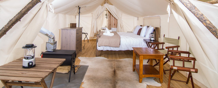 glamping_arizona_under_canvas_grand_canyon_tent_interior_view_bed_tables-.jpg
