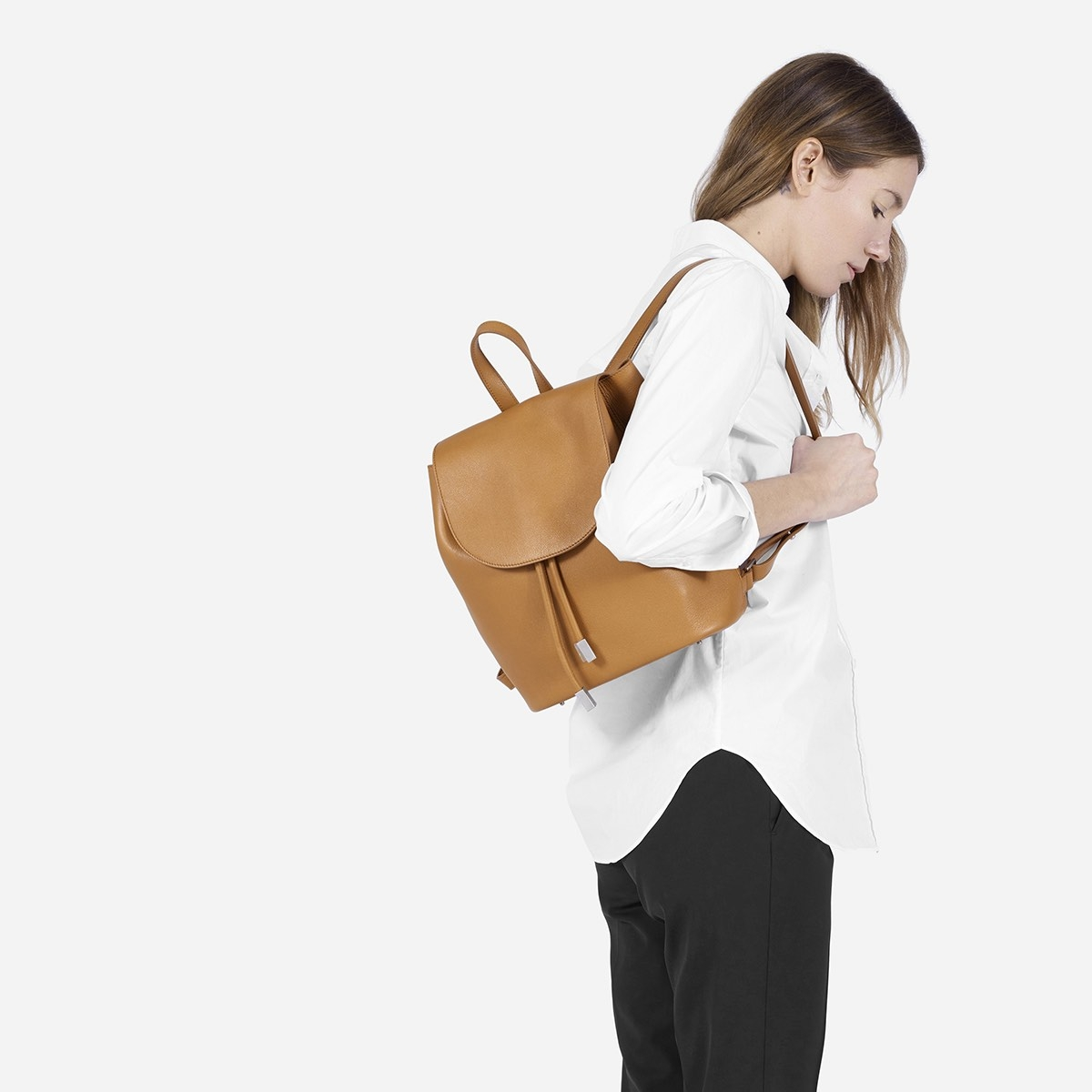 """<h2><a href=""""https://www.everlane.com/products/petra-backpack-tan?collection=womens-backpacks-bags"""">Everlane Petra Backpack, $330</a></h2>"""