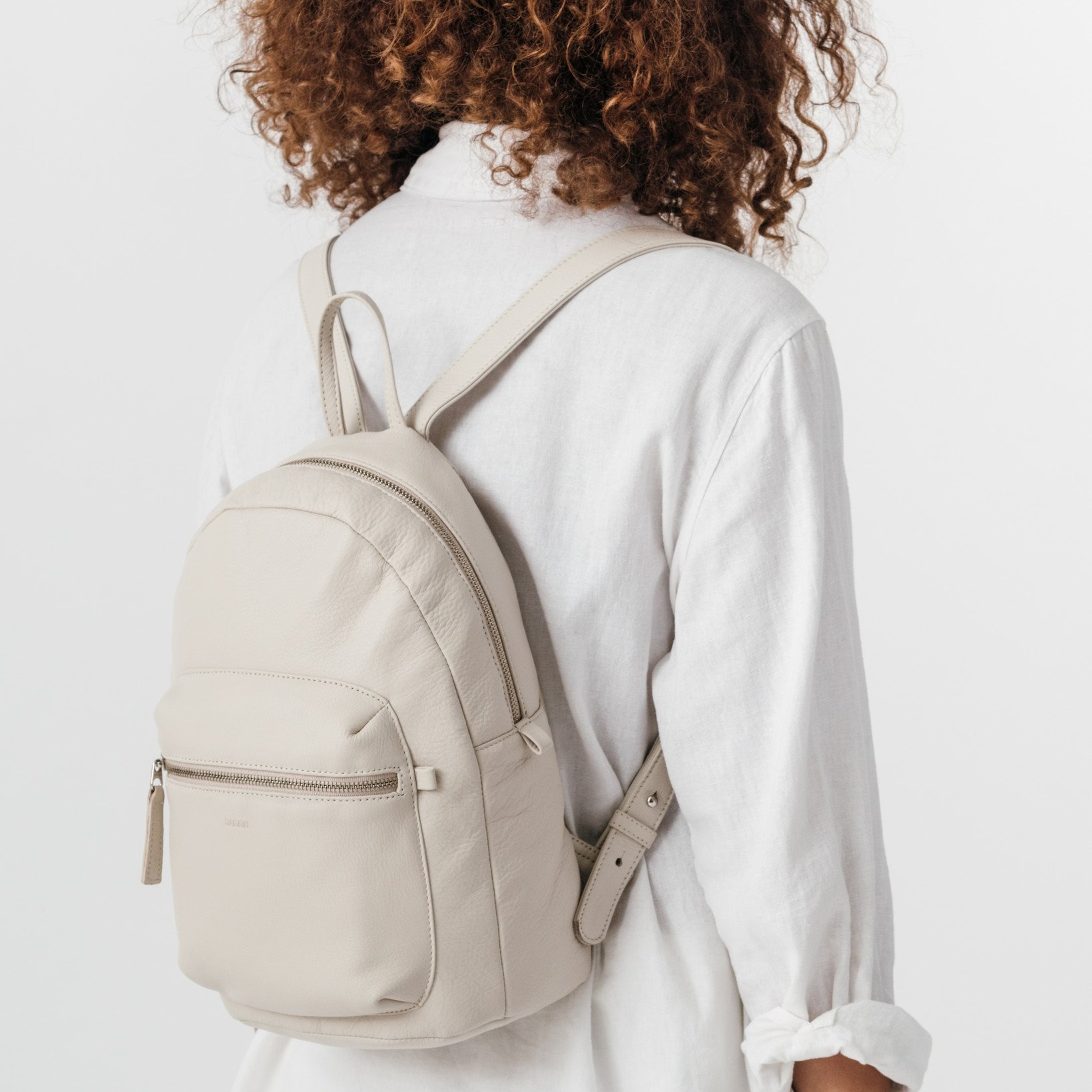 """<h2><a href=""""https://baggu.com/collections/category-backpacks/products/leather-backpack-stone?variant=30974652871"""">Baggu Leather Backpack, $224</a></h2>"""