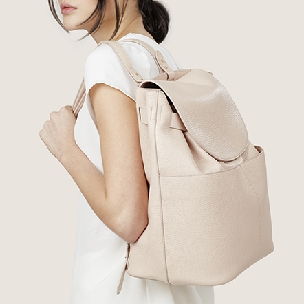 """<h2><a href=""""https://www.cuyana.com/leather-backpack.html#blush"""">Cuyana Leather Backpack, $350</a></h2>"""
