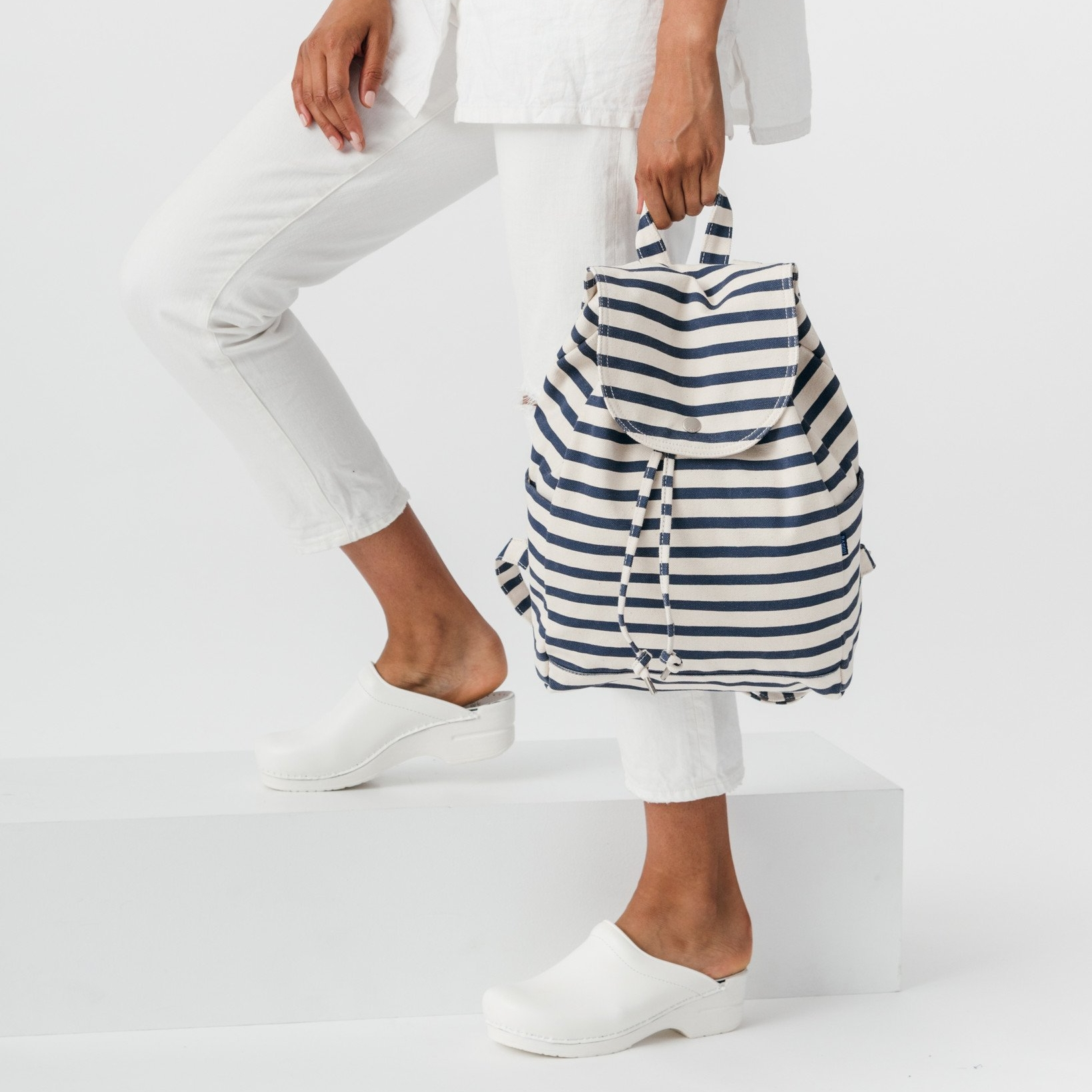 """<h2><a href=""""https://baggu.com/collections/category-backpacks/products/drawstring-backpack-sailor-stripe?variant=30968907015"""">Baggu Drawstring Backpack, $42</a></h2>"""