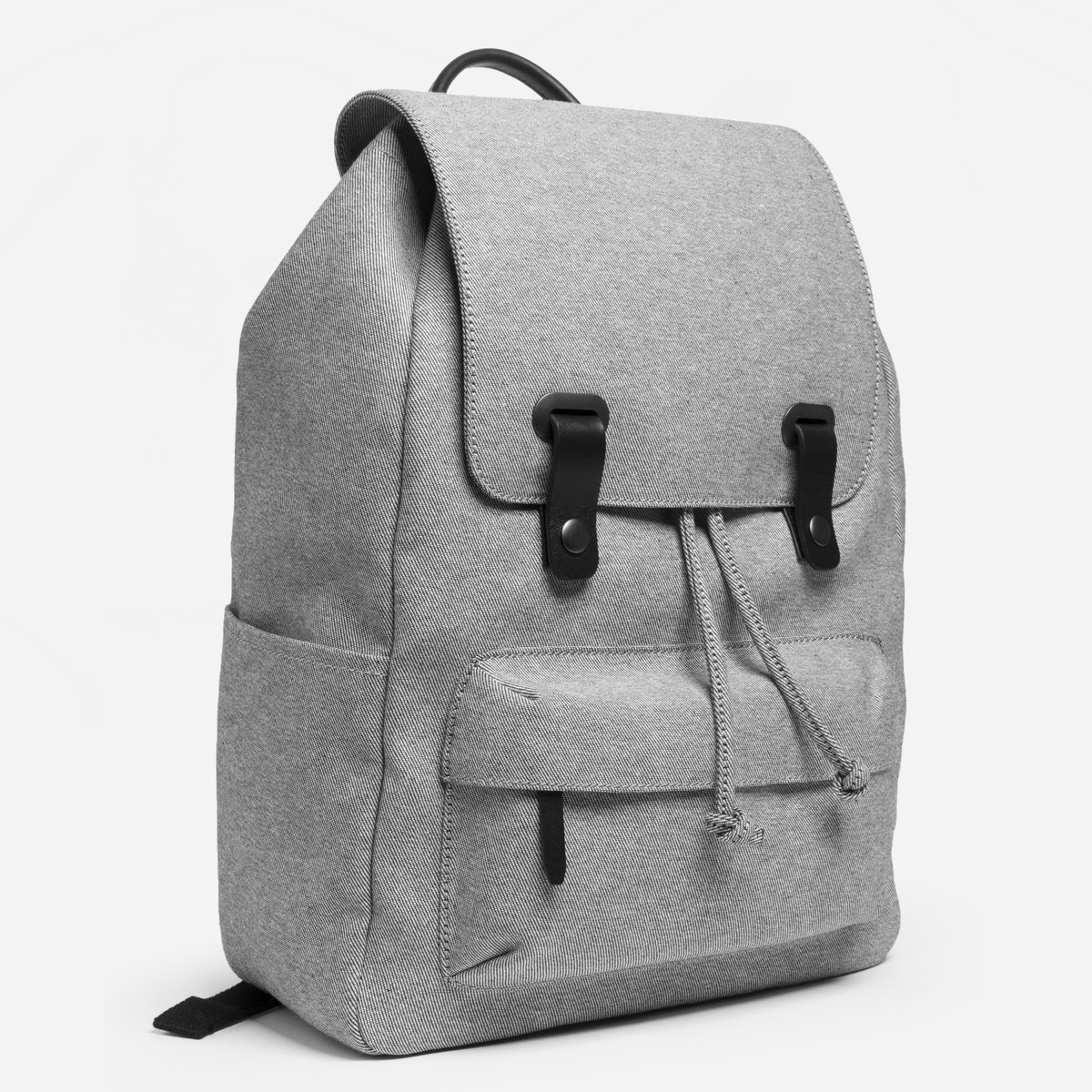 """<a href=""""https://www.everlane.com/products/womens-twill-backpack-reverse-denim-black-leather?collection=womens-backpacks-bags""""><h2>Everlane Twill Snap Backpack, $65</a></h2>"""