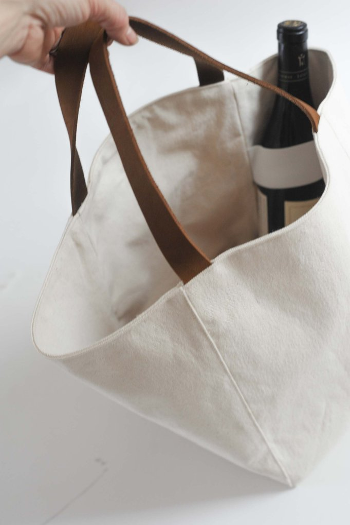 Millie Lottie Branch Tote, $120 - Perfect for picnics, trips to the farmer's market, or simply hauling things. The $120 price tag includes a cutting board that fits in the base. Don't need another cutting board? Save $30 and get it without.