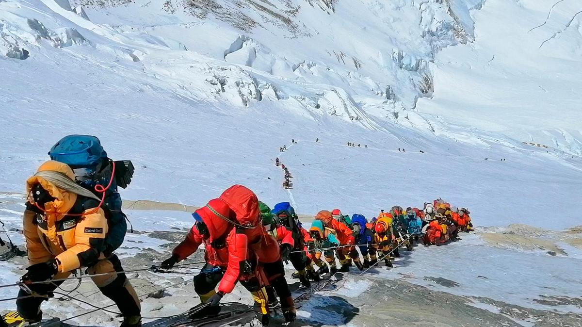 Petroleum-based products hike up Everest. Don't these people know there are 7+ billion others they share the planet with? Credit: AP