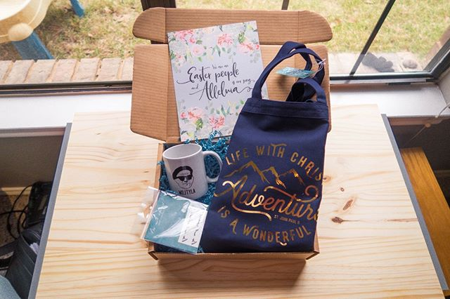 This month's LumiBox features a tote from @livelyfaithco a JPII mug from @palcampaign a temporary tattoo in JPII's handwriting from Just Love Prints, and a art print from Jessica Marie!