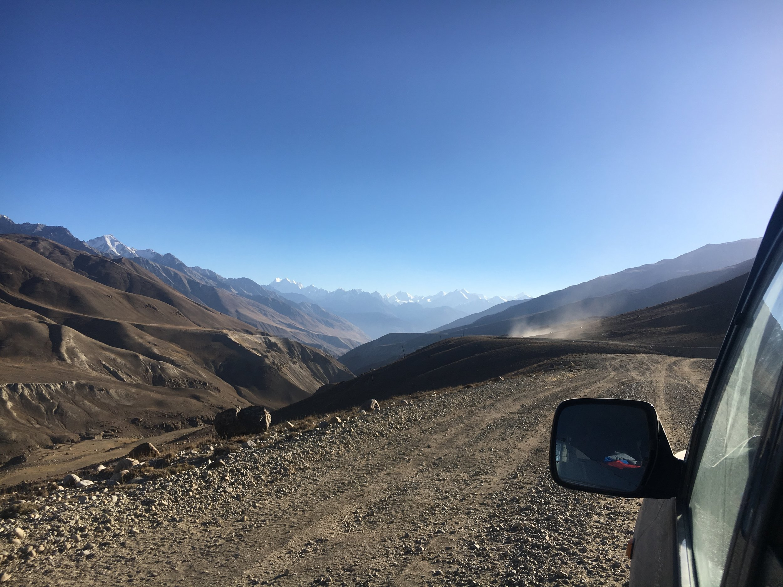 PECTA driver somewhere between Khargush Pass and Langar. Left side: Afghanistan
