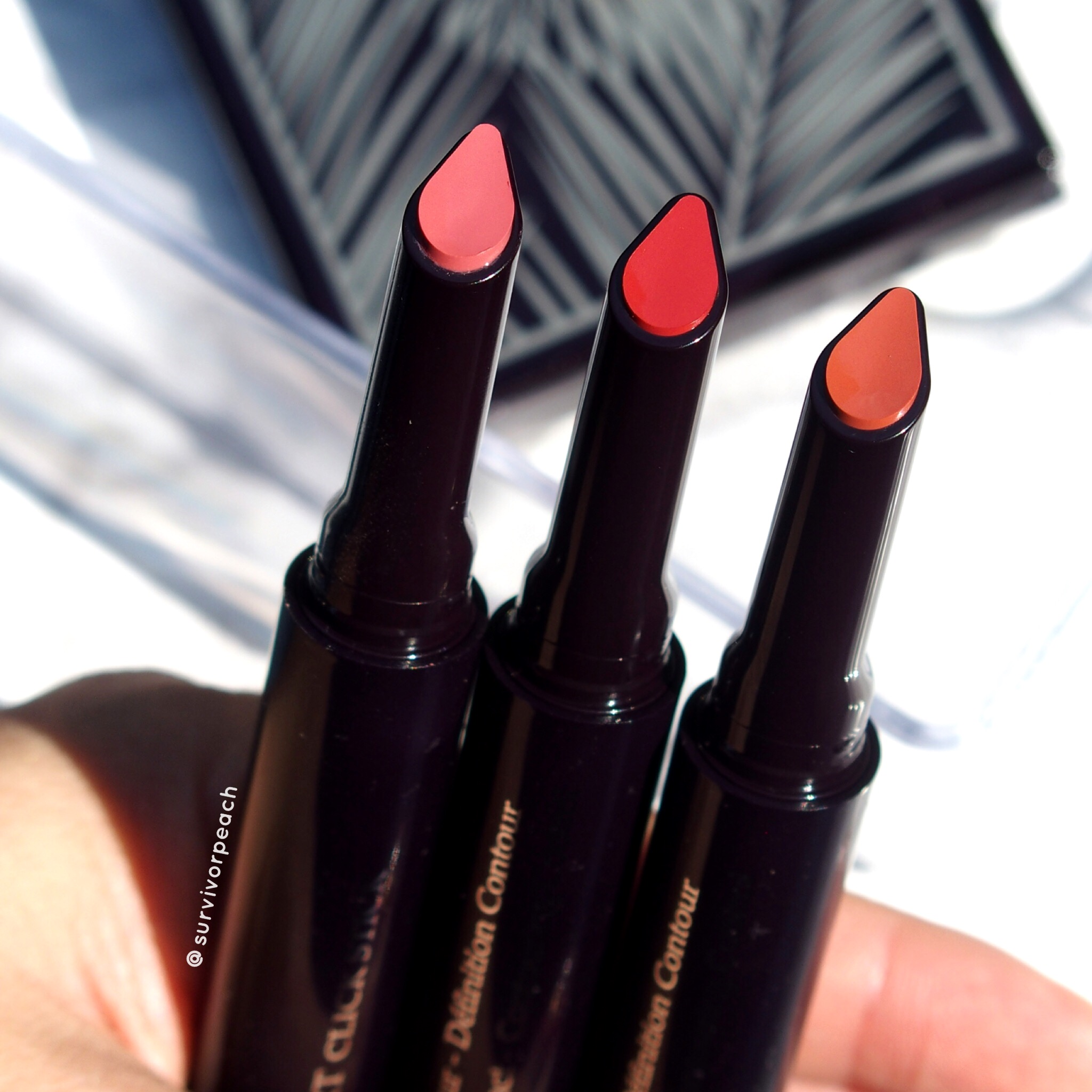 Rouge Expert Click sticks in #6 Rosy Flush, #11 Baby Brick, and #12 Naked Nectar.