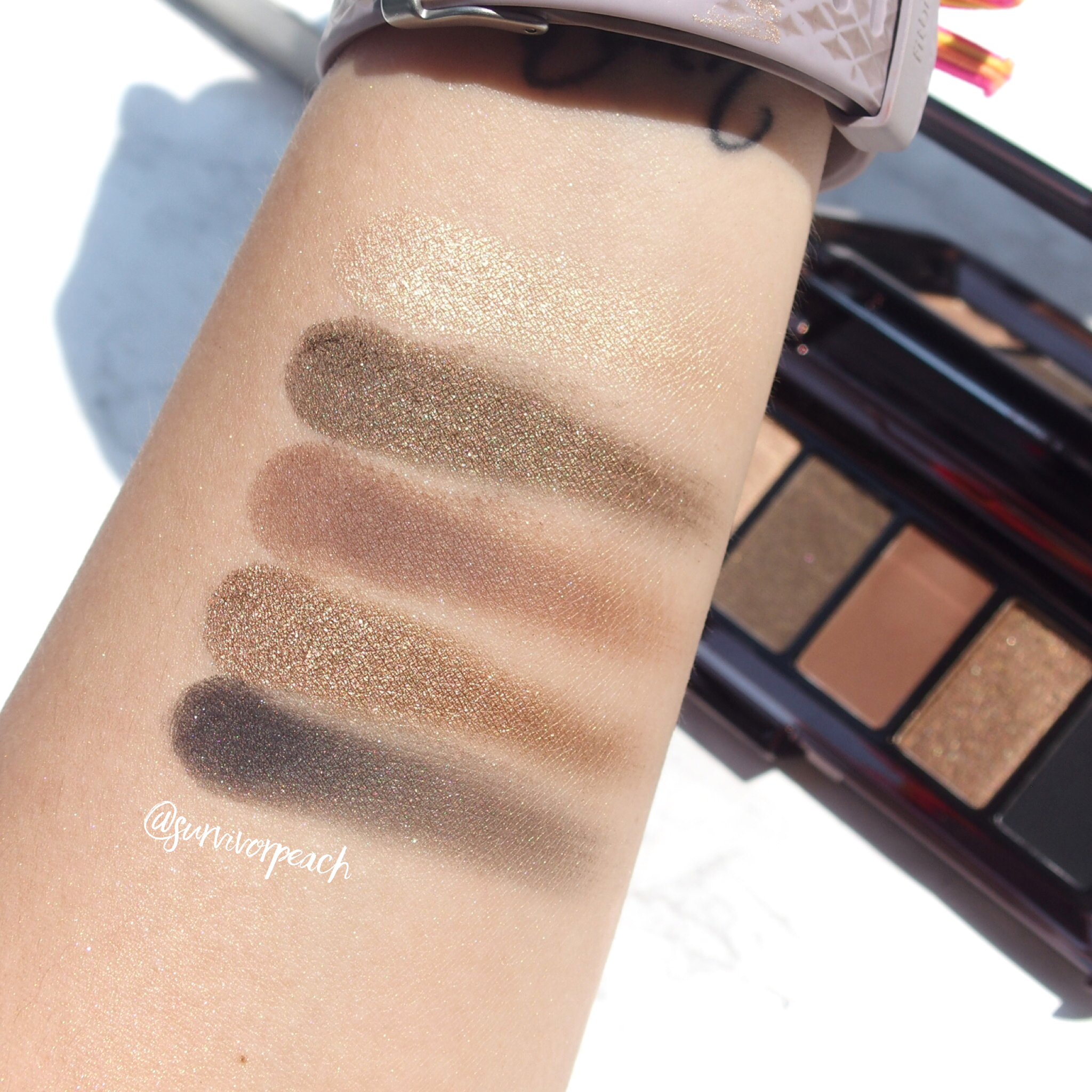 Swatches of the Hourglass Graphik Eyeshadow Palette Vista