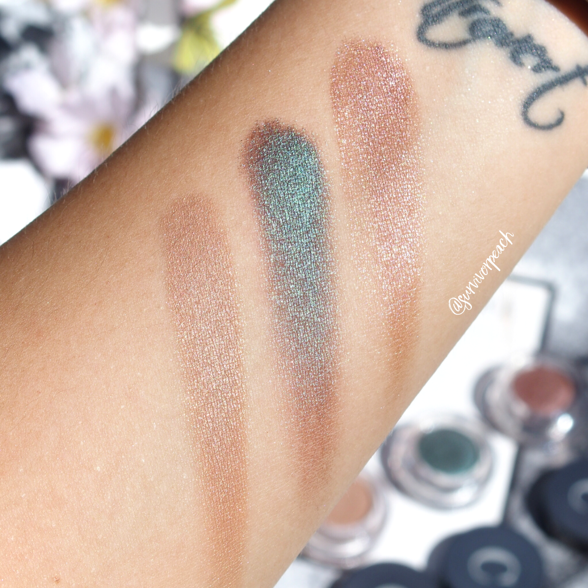 Swatches of the Chantecaille Mermaid Eye Shades in Starfish, Lagoon, and Sylvie.