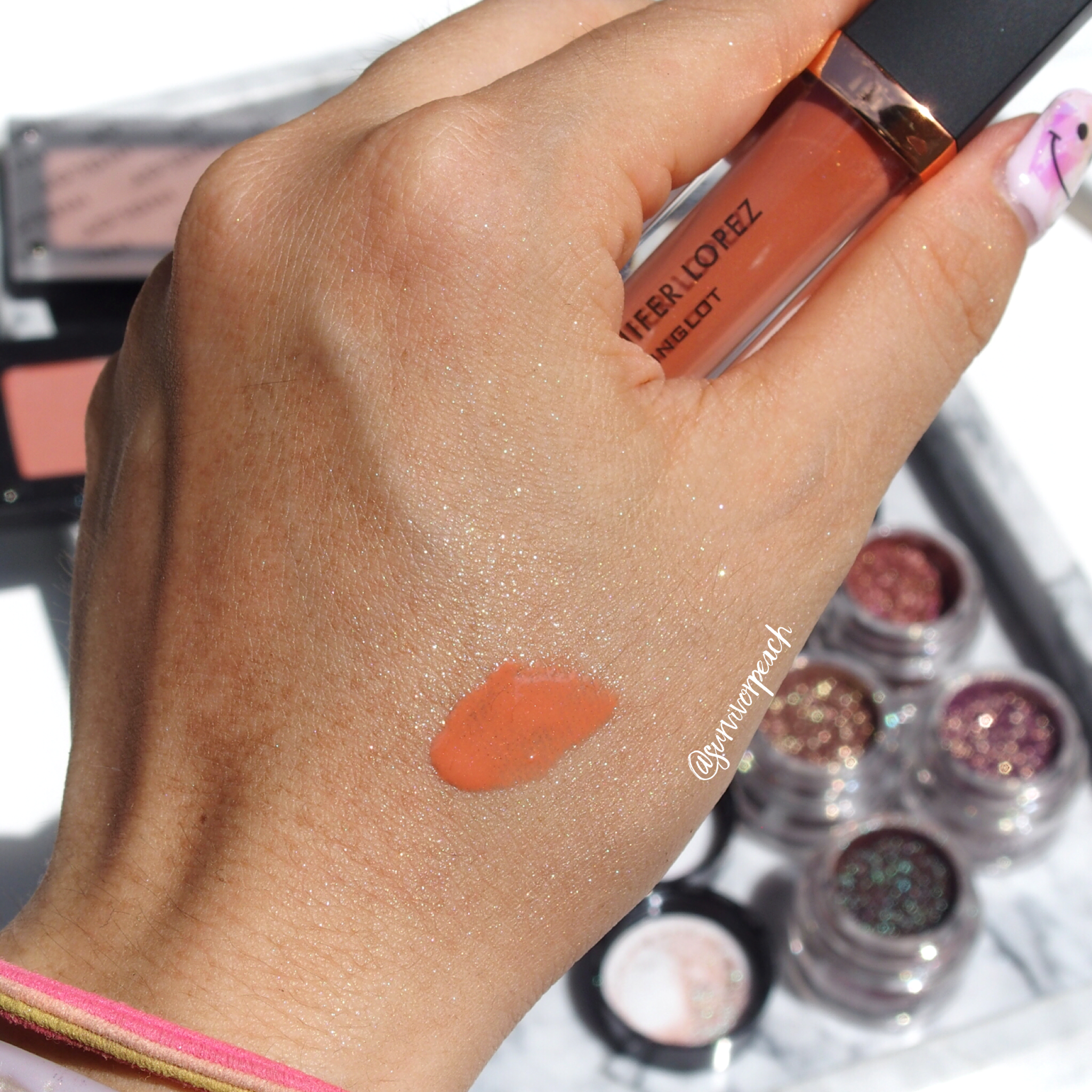 Inglot JLo collab Lip Glossy Lip Gloss in shade Peach Pearl swatch