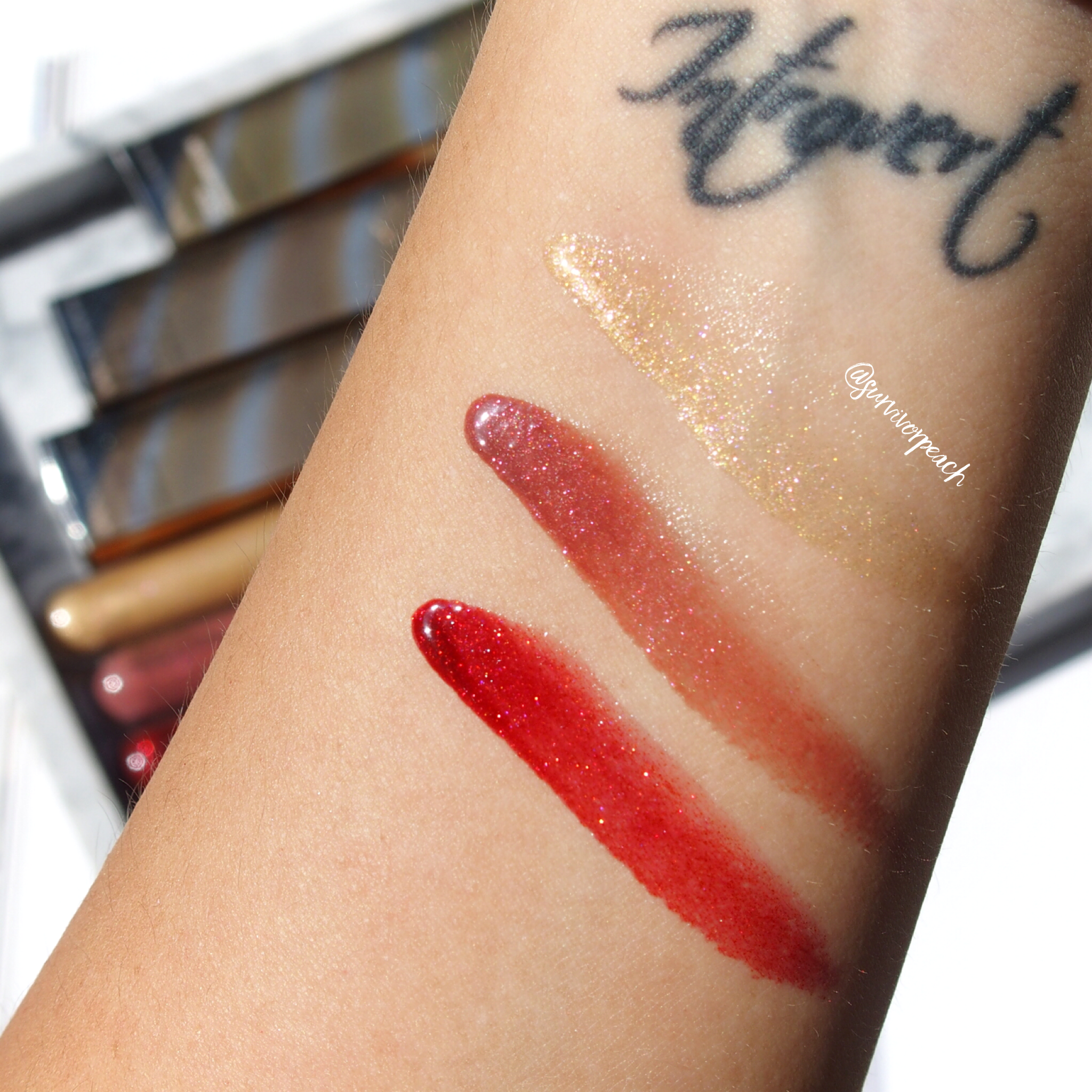 Swatches of the Becca Volcanic Goddess Glow Glosses Metamorphic Gold, Molten Mauve, and Ruby