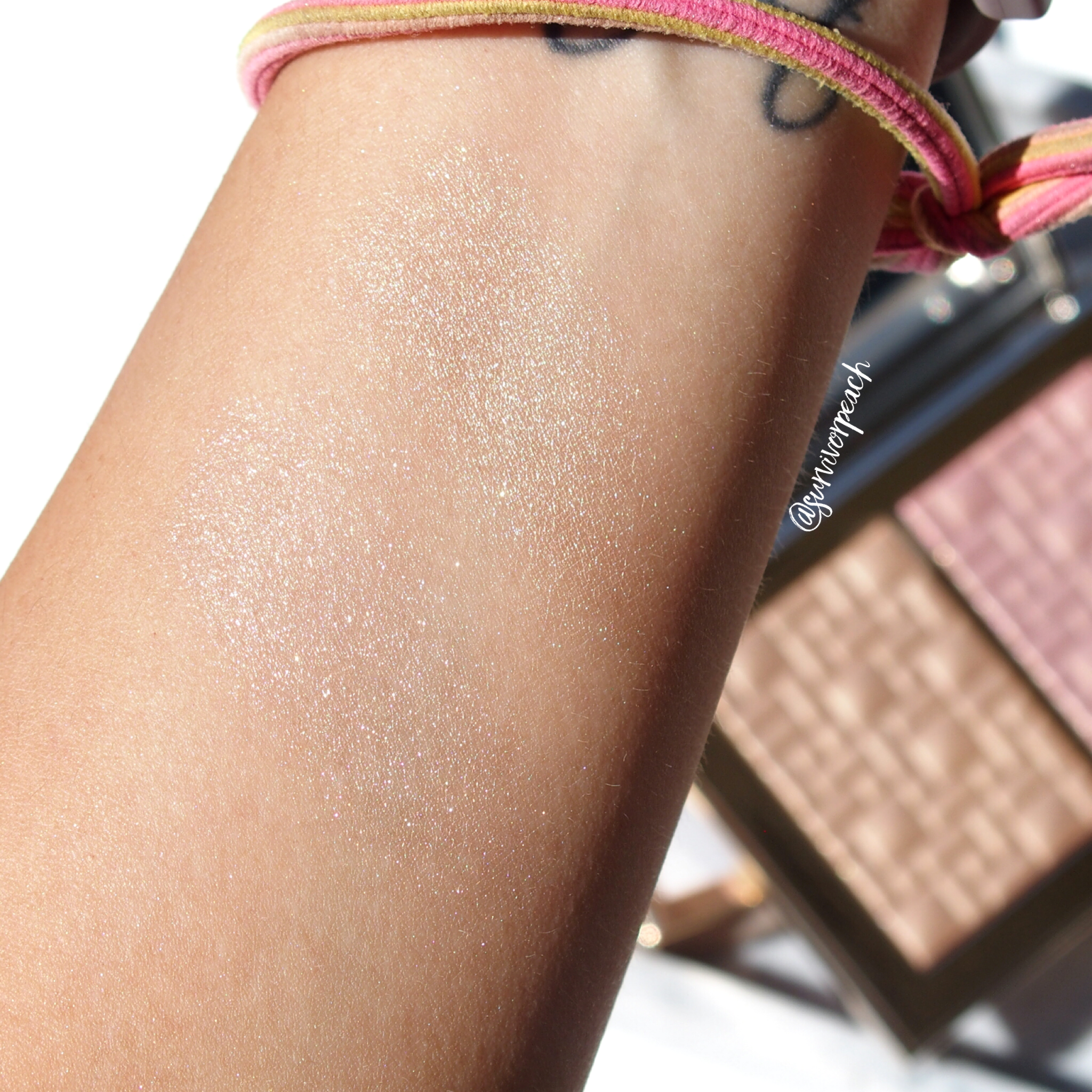 Swatches of the Bobbi Brown Highlight & Glow Highlighting Powder Duo in Opal Glow and Bare Glow