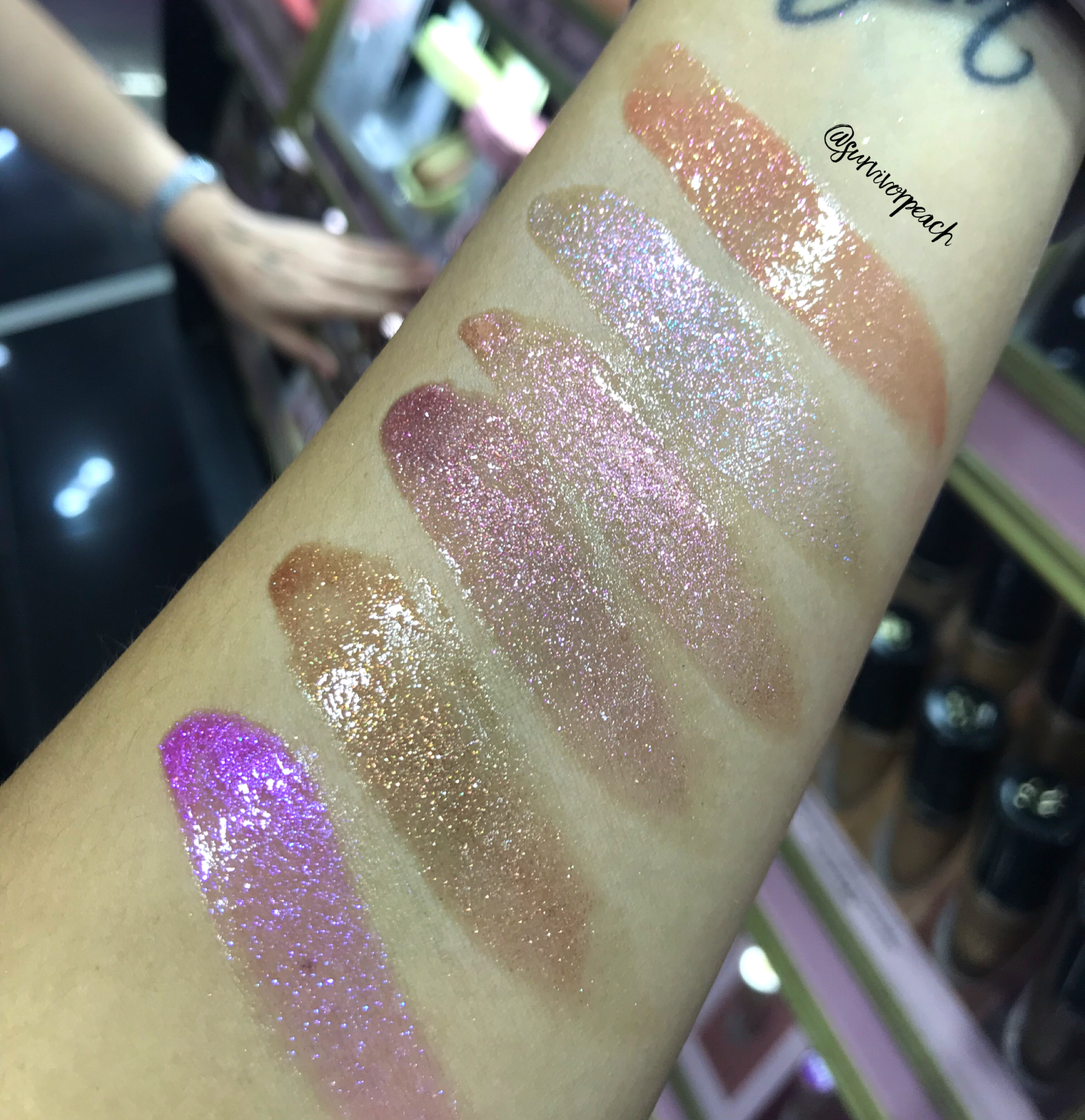 Swatches of the Toofaced Rich & Dazzling High Shine Sparkle Lip Gloss in Social Butterfly, All the Stars, Sunset Crush, Raisin the Roof, Pretty Penny, 40K