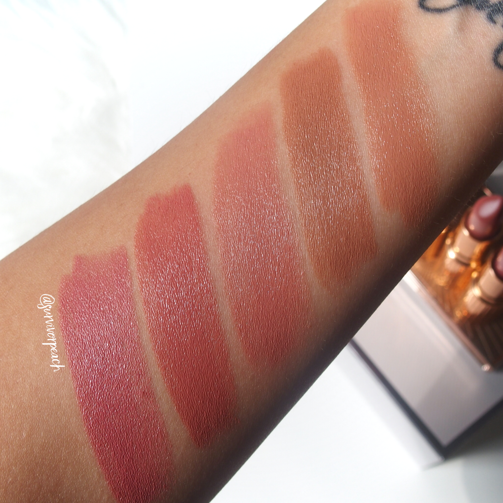 Swatches of the Charlotte Tilbury K.I.S.S.I.N.G Lipsticks in shades Penelope Pink, Hepburn Honey, Bitch Perfect, American Sweetheart, The Duchess