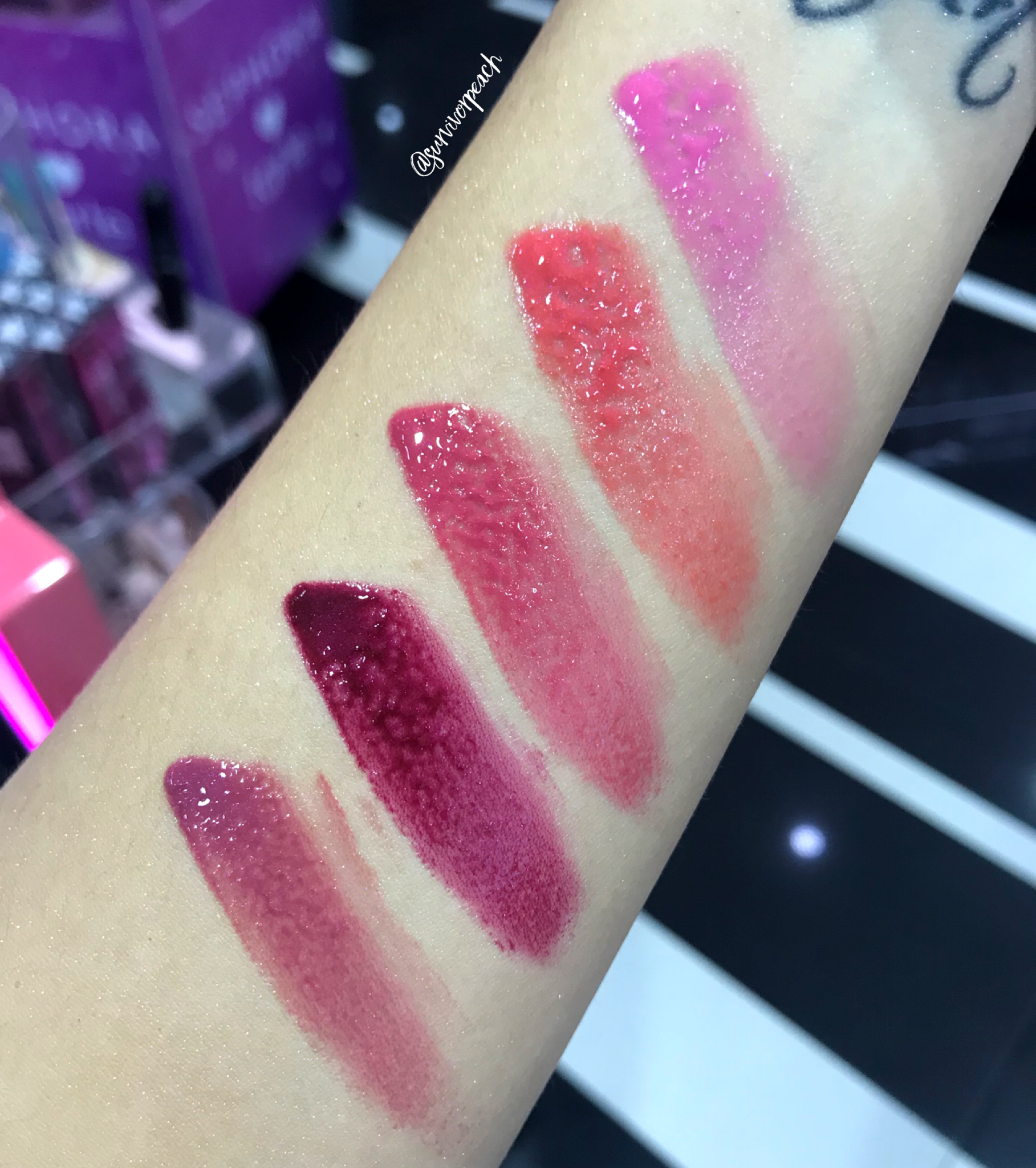 Becca Glow Gloss swatches: Camellia, Tigerlily, Snapdragon, Foxglove, Dahlia