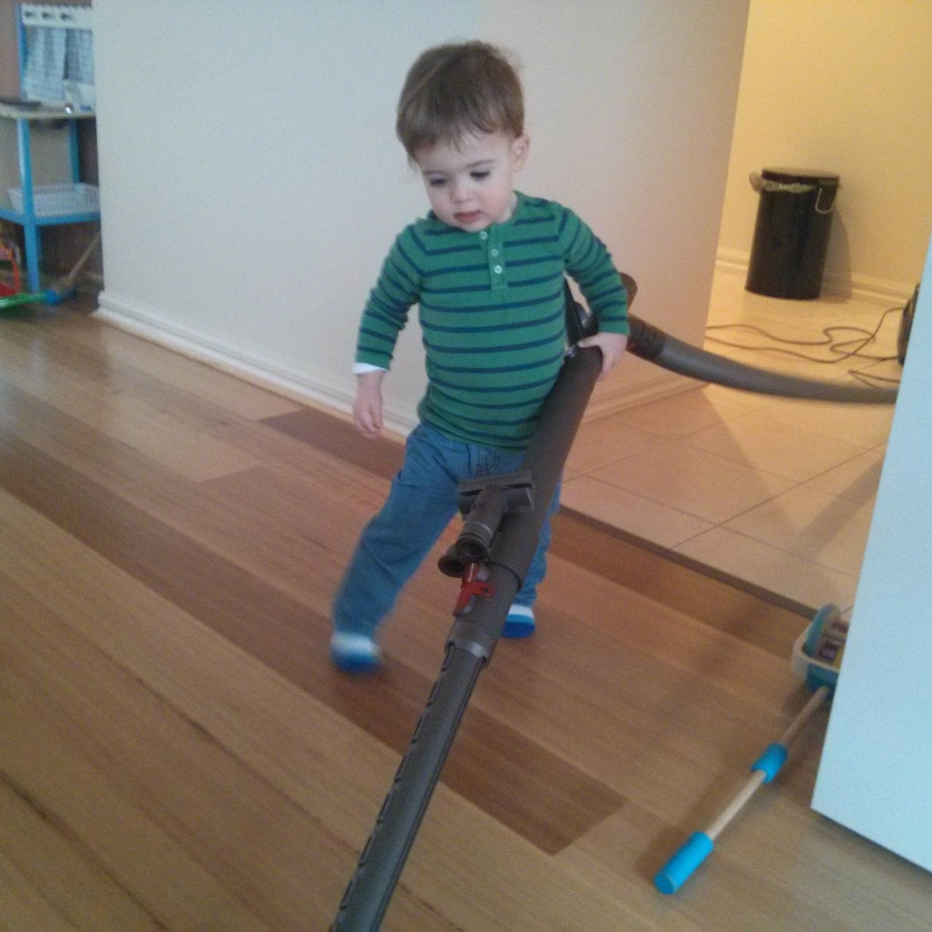 child vacuuming
