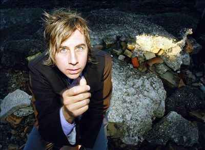 """EXAMINER.COM Interview: John Vanderslice        John Vanderslice  has a reputation for being one of the nicest guys in the music biz. The 43-year-old singer-songwriter has been on the scene as a solo artist for more than a decade, and also served as proprietor of San Francisco-based recording studio  Tiny Telephone  for nearly 15 years, so needless to say, he's garnered quite a bit of a following.  Outside of the music world, he is not only a charismatic individual, but instantly likable, due in large part to the genuineness of his spirit. His diction is peppered with the words """"like"""" and """"totally"""" and he speaks with a thoughtful and somewhat restrained confidence. As he talks, he emanates a real enthusiasm in the oft-boyish charm that encompasses his words and belies his age. And on this particular Friday night, he's amped up on the release of his latest album, """"White Wilderness,"""" on the  Dead Oceans  label, just days earlier. He answers the phone as he's arriving at Arizmendi Bakery to pick up cookies for him and his wife to enjoy at home, something which constitutes a big night out for Vanderslice.  """"My wife Isabelle is, like, the coolest person on earth,"""" he said of his bride of more than four years, a native of France.  Vanderslice, who once was employed as a waiter, said that working evening shifts on the weekend never bothered him so much. And even now that he's moved on from the profession, he still prefers to spend Friday nights at home.  """"I found there was something amazing about, like, doing your work on a night that everyone else is out, like, going crazy,"""" he said. """"There's something virtuous about it…weekends are great for being home.""""  One of the luxuries of being a solo artist is having those weekend nights free to stay in. And Vanderslice, who is a veteran of a handful of indie rock bands, finds that being an independent solo artist is much more liberating for him overall, in the sense that he's able to make his own decisions, worry about only his o"""