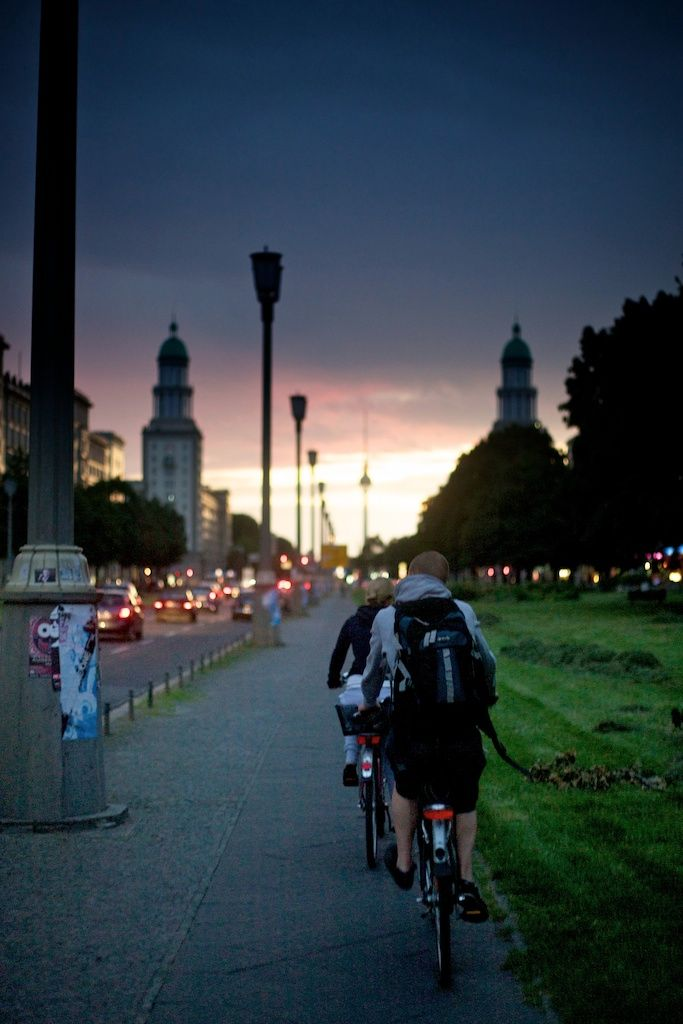 """SLOW TRAVEL BERLIN   Berlin: Be Our Valentine?    Cycling City   """"It wasn't until I got a bike that I first got to know Berlin. For the months before that, she was the mistress who swept me off my feet, compelling me to move one-third of the way around the world on a whim. She exuded a rough charm, and her quirky charisma captivated me. But we were still strangers in a sense, until I began to bike her streets. Once I started exploring on two wheels, I saw a side of Berlin I hadn't been exposed to before. With walking, you are often limited by how fast and far you can travel, and with public transportation, the city can feel disconnected when you go underground at one place and """"pop up"""" in an entirely different one, not knowing what ground you covered in between. But when you ride a bike around Berlin, suddenly it makes sense, the streets connecting like synapses in the brain. And it confirms that your hunch was correct–Berlin truly is an intoxicating, diverse, and irresistible place.""""   Natalye Childress"""