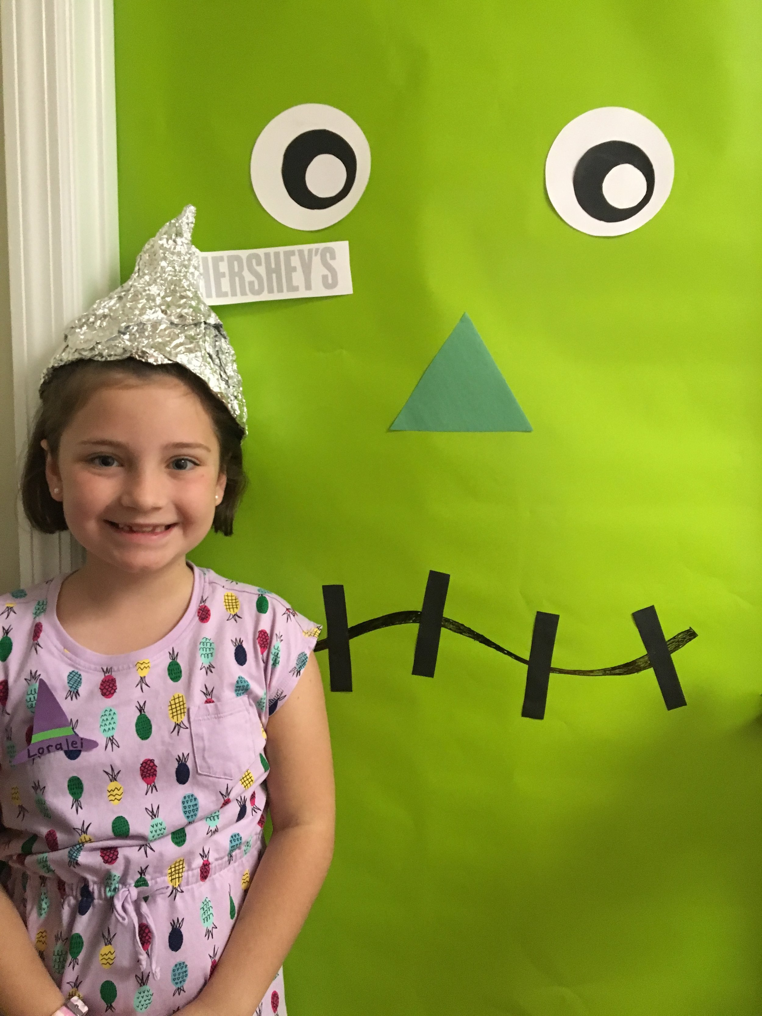 She makes that Hershey Kiss hat look even sweeter!