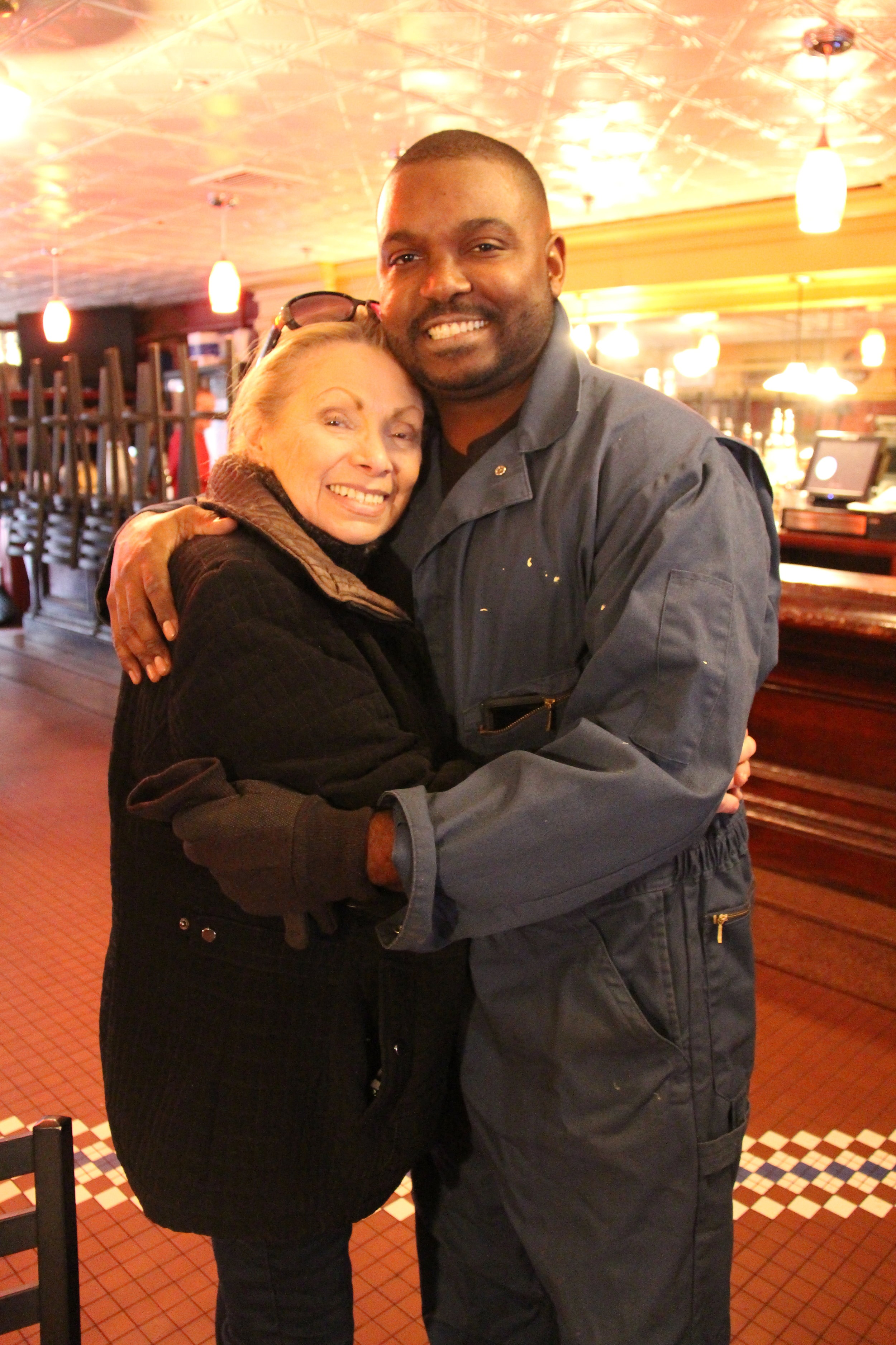 Gina Schertzer, head waitress, and Roberto Reyes, executive chef, give each other a quick embrace. Reyes, who was working alongside staff to dismantle the kitchen, stopped what he was doing just long enough to joke about who makes the best meatballs. Photo: Karen Bento
