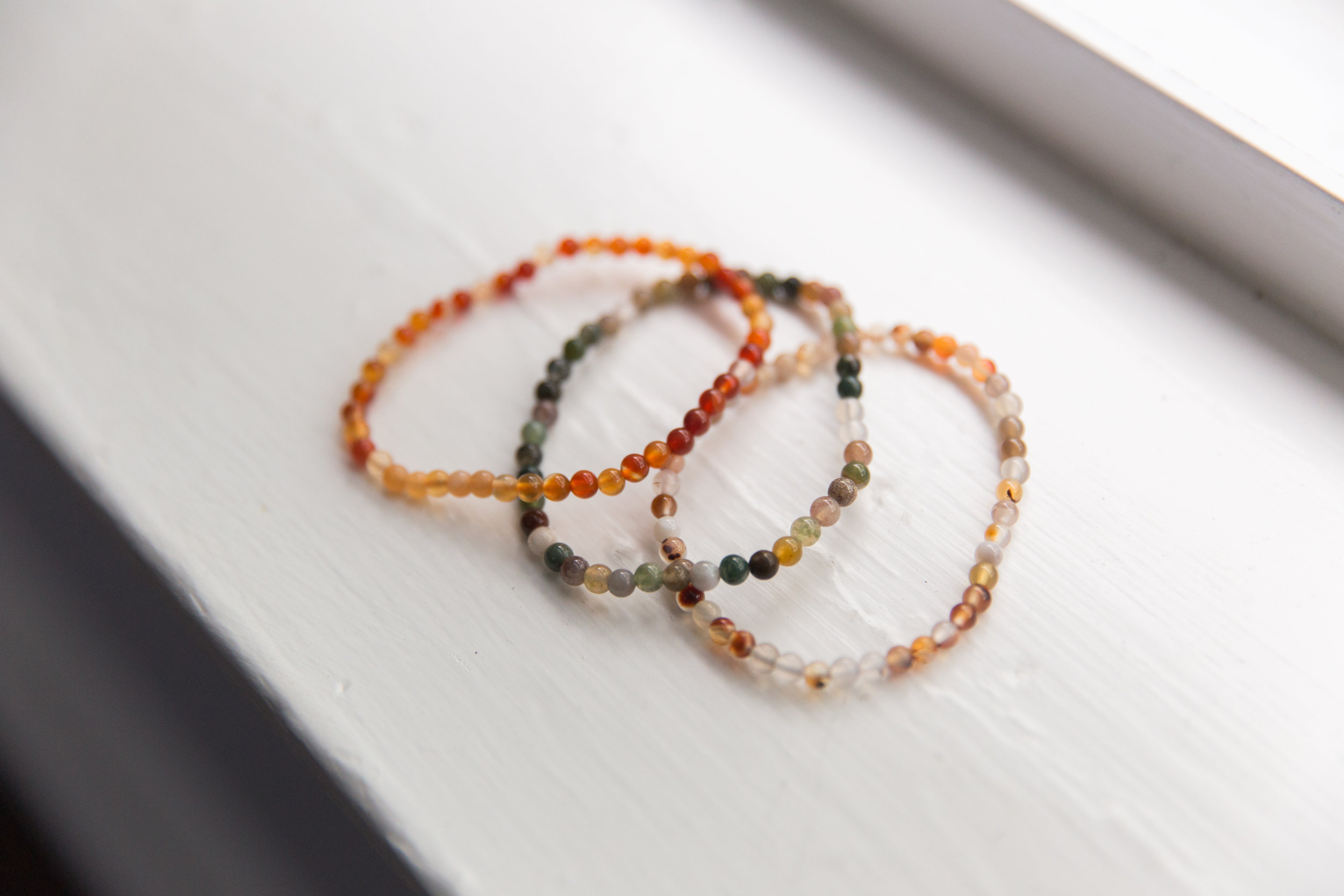 Milk and Honey Bracelets, $8   Beautiful bracelets with healing stones made by local company  Milk and Honey .